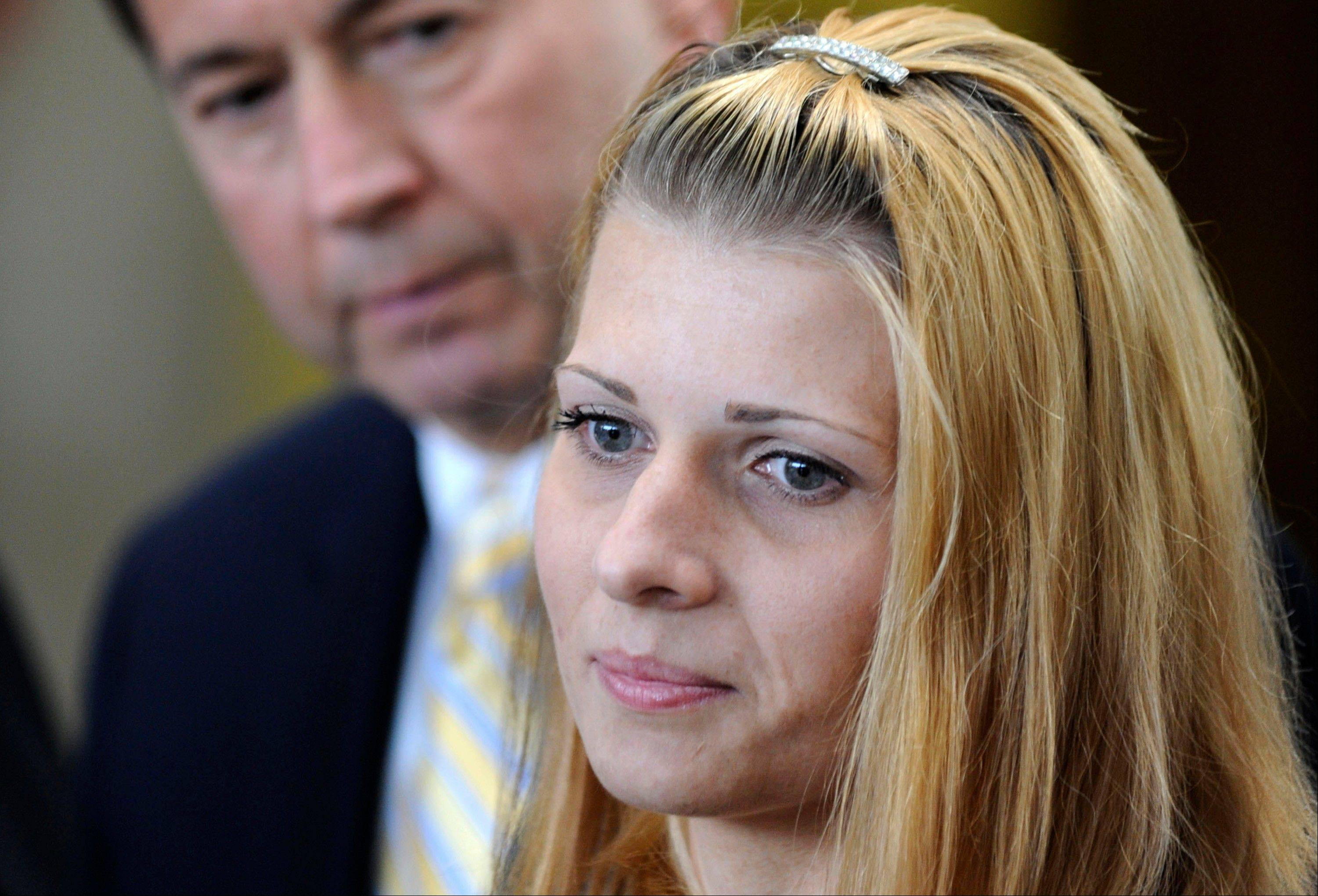 Bartender Karolina Obrycka, right, with attorney Terry Ekl, was the victim of a beating by an off-duty Chicago police officer.