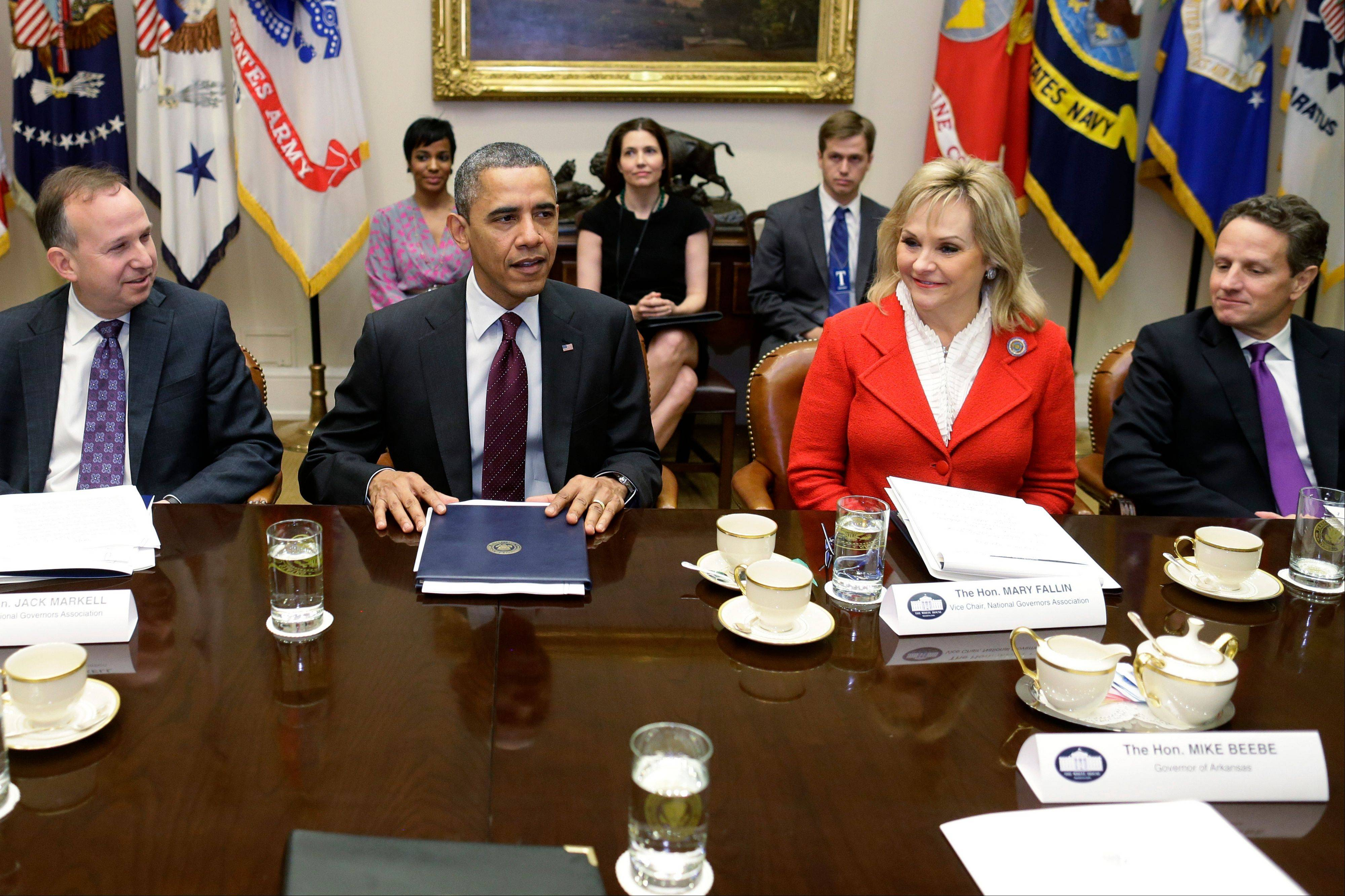 President Barack Obama, flanked by National Governors Association (NGA) Chairman, Delaware Gov. Jack Markell, left, and NGA Vice Chair, Oklahoma Gov. Mary Fallin, meets with the NGA executive committee regarding the fiscal cliff Tuesday at the White House. Treasury Secretary Tim Geithner is at right.