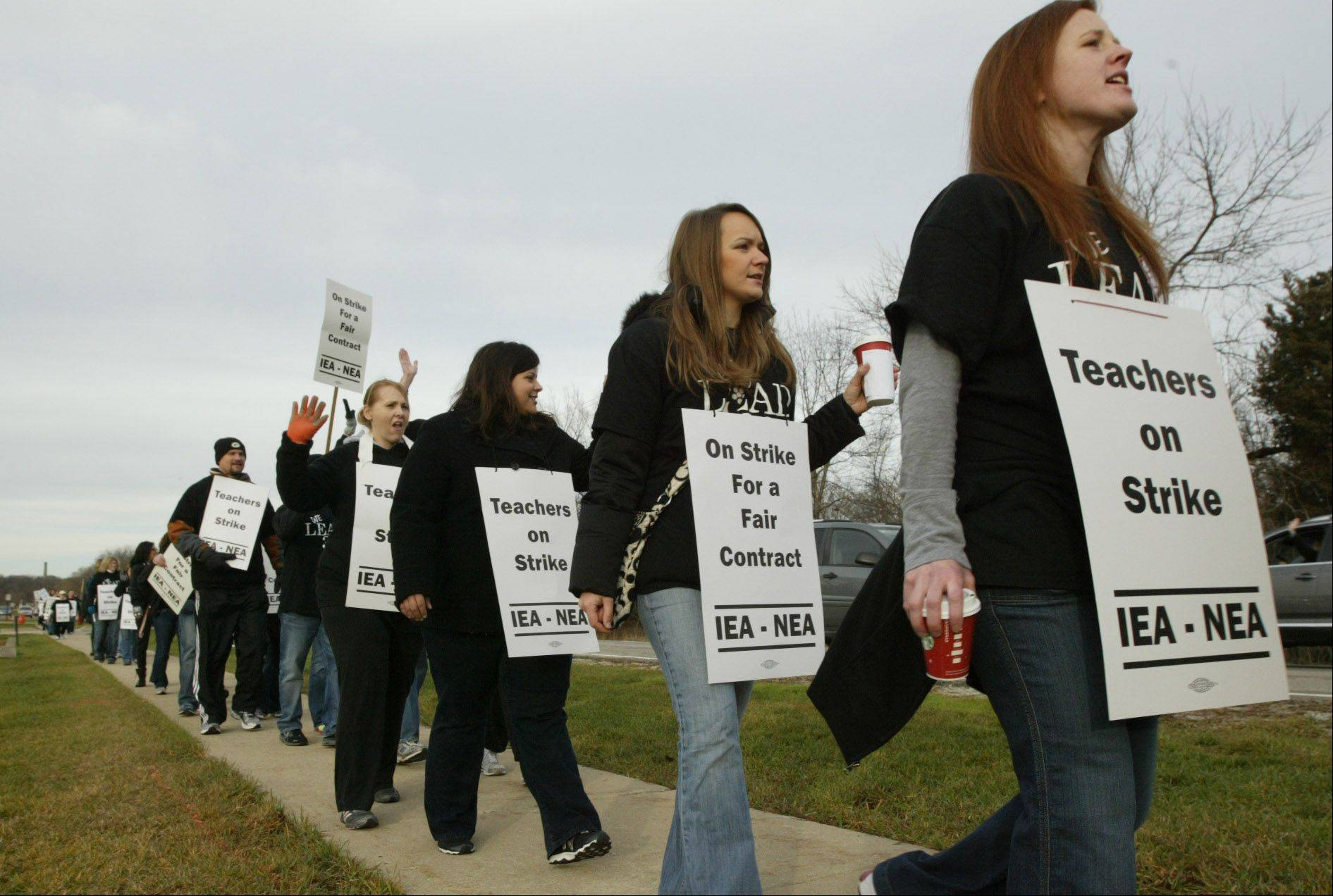 Community Unit District 300 teachers walk the picket line Tuesday morning outside district headquarters after the teachers union went on strike.