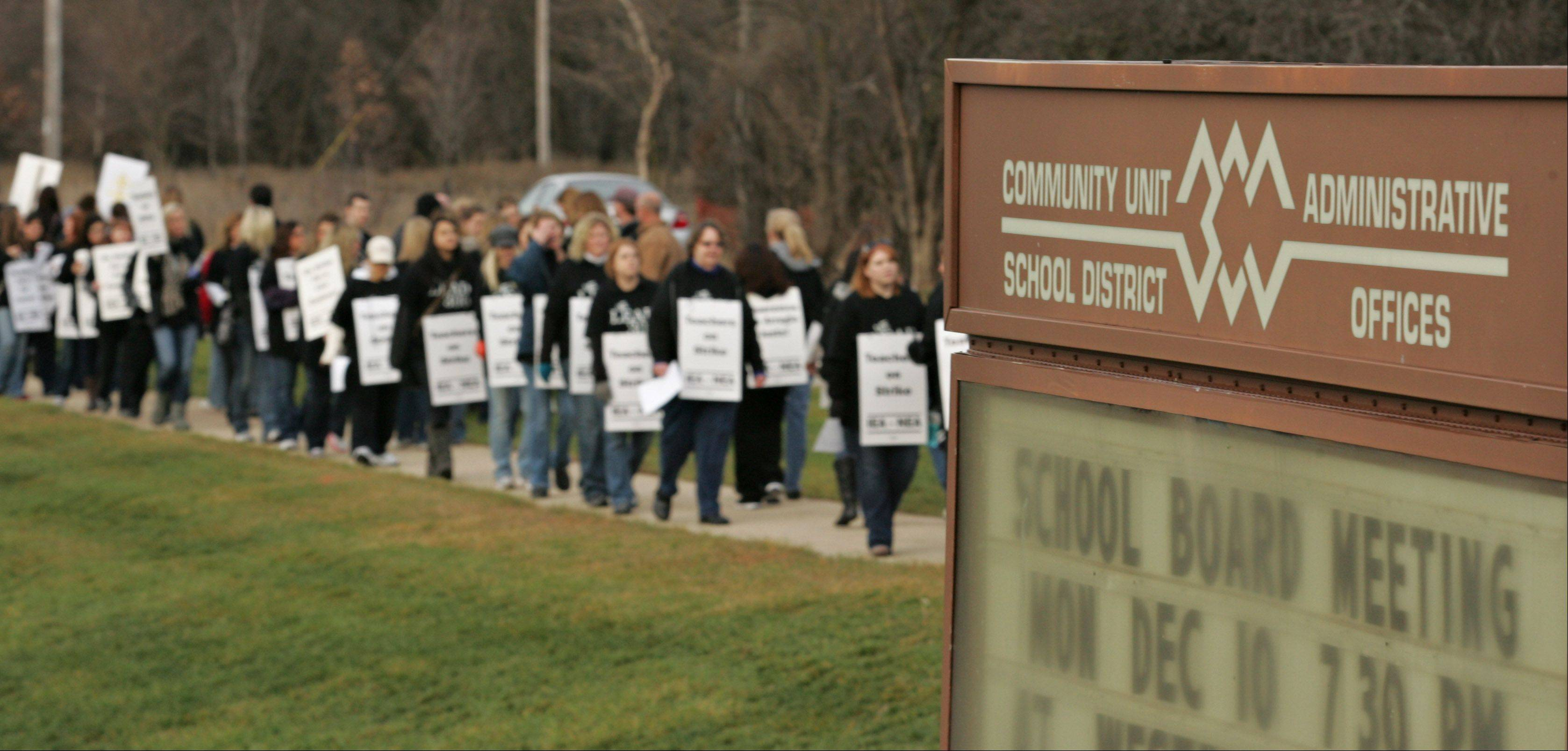 Striking Community Unit District 300 teachers picket near the district headquarters Tuesday morning in Carpentersville.