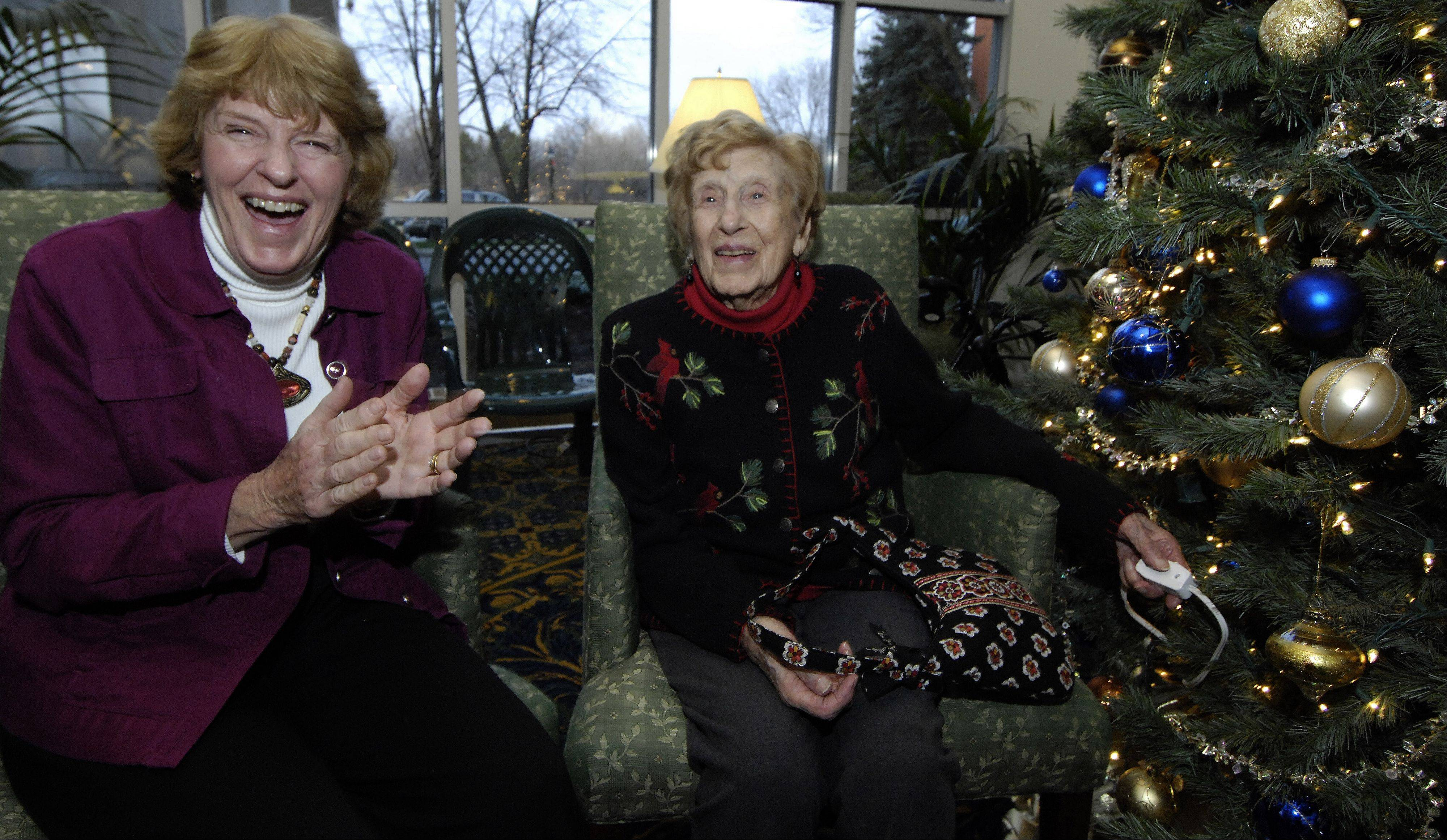 JOE LEWNARD/jlewnard@dailyherald.comLois Arbanas marked her 105th birthday by lighting the Christmas tree at The Moorings of Arlington Heights with her daughter, Anne Feichter of Elk Grove Village. Arbanas says the key to her longevity has been doing things in moderation.