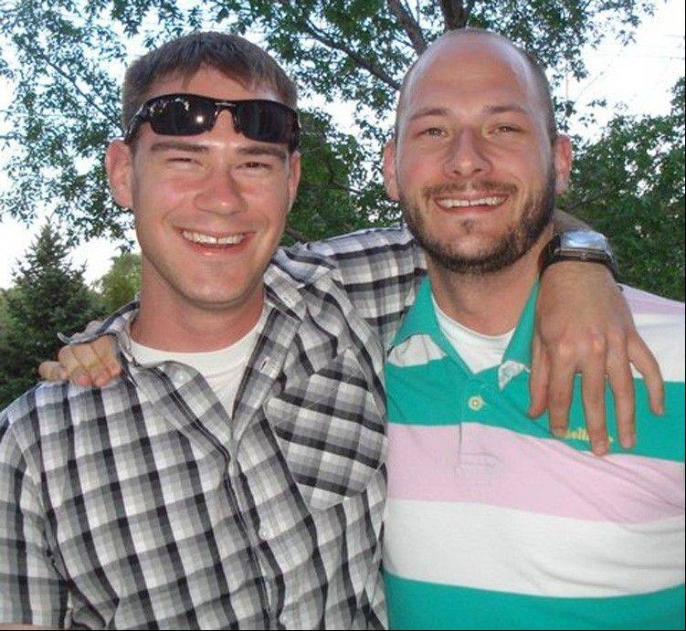 This family photo provided via The Kalamazoo Gazette shows Army Capt. Drew E. Russell, left, with his brother James, in Colorado, just before being deployed to Afghanistan in the summer of 2011. For Russell's family, the anguish of his death is still fresh. His father, Jim, said the loss was even harder to accept after learning from the Army's investigation report early this year that it was a supposed ally, not the Taliban, who killed his son.