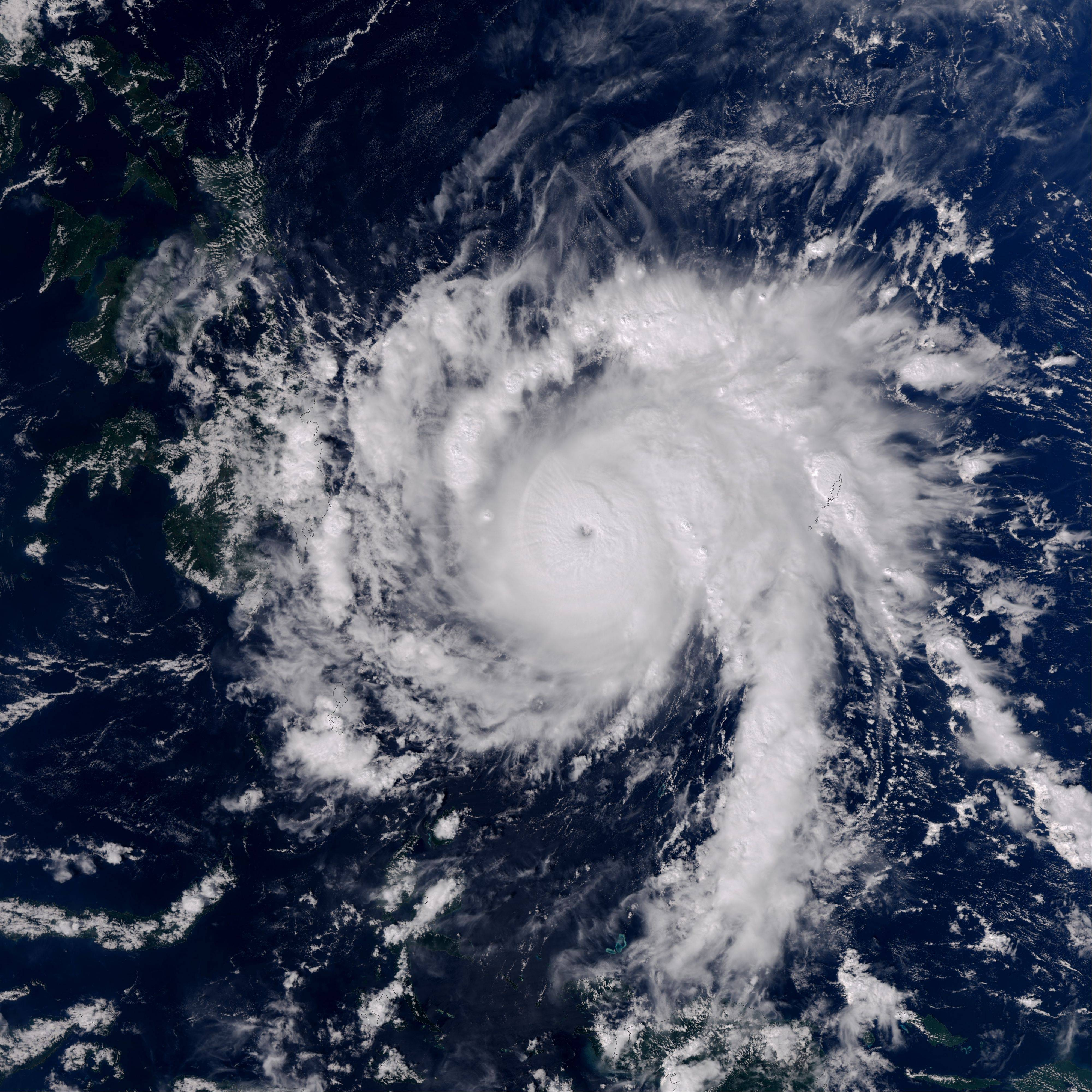 This Earth Observatory image made on Monday, provided by NASA, shows Typhoon Bopha moving toward the Philippines. Typhoon Bopha slammed into the Davao region of the Philippines early Tuesday, killing at least seven people and forcing more than 50,000 to flee from inundated villages.
