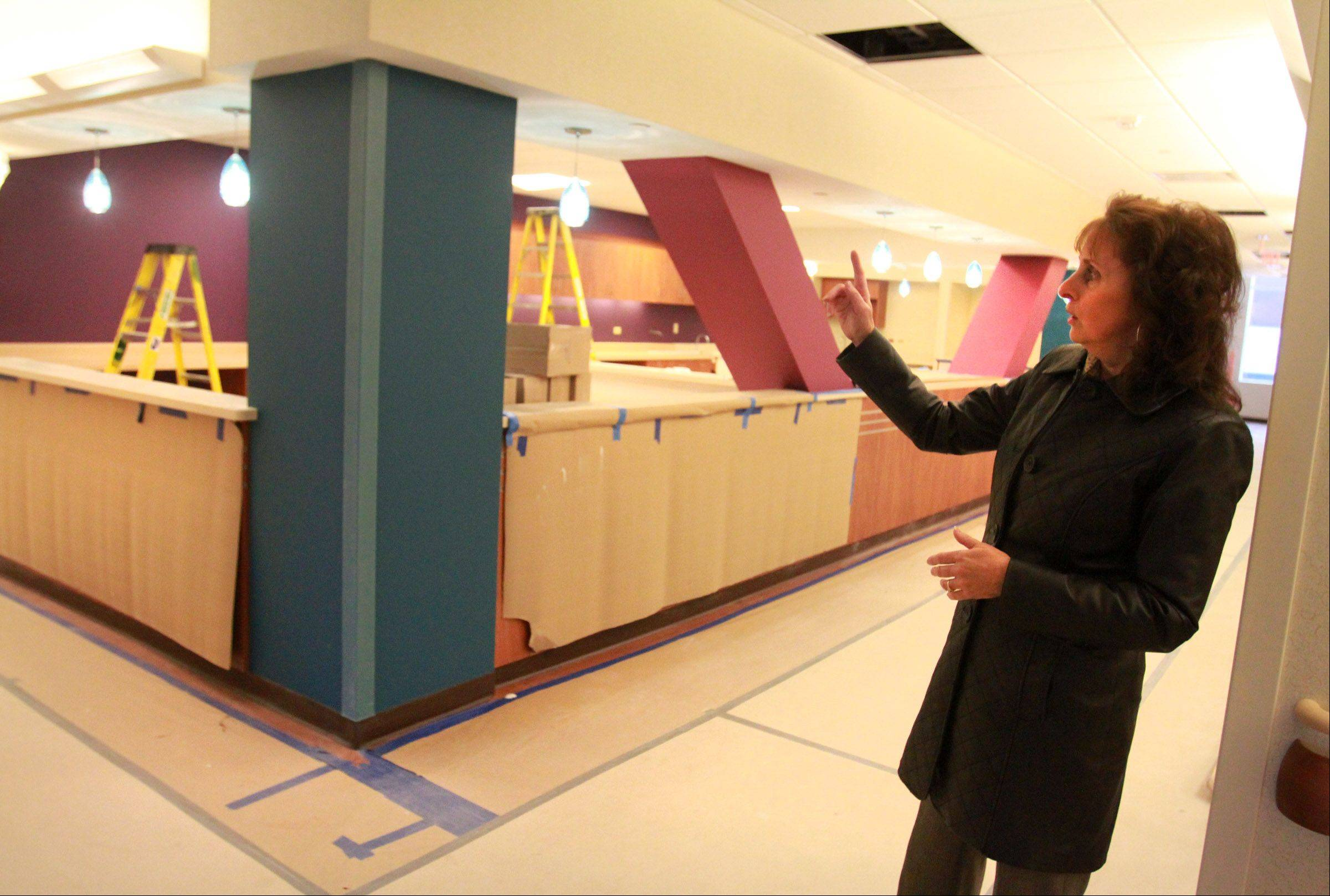 Joan Cappelletti, executive director of nursing at St. Alexius Medical Center, talks about a nursing station in the new Alexian Brothers Women and Children's Hospital in Hoffman Estates. Construction on the hospital, which is slated to open in the spring, is well under way.