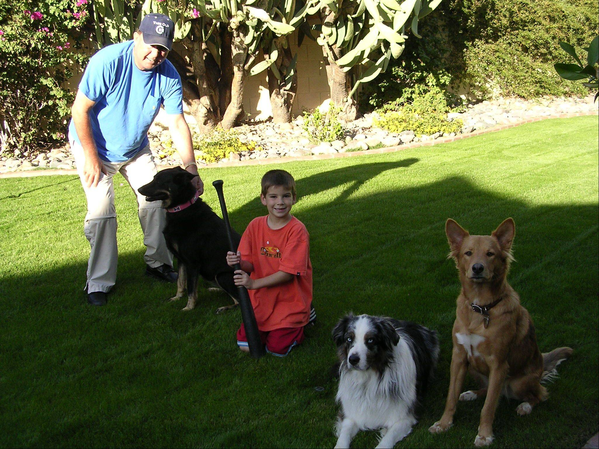 Dogs and children played big roles in Ron Santo's life. Here he is with his grandson Sam and three dogs, from left: Hanna, Joker and Summer.