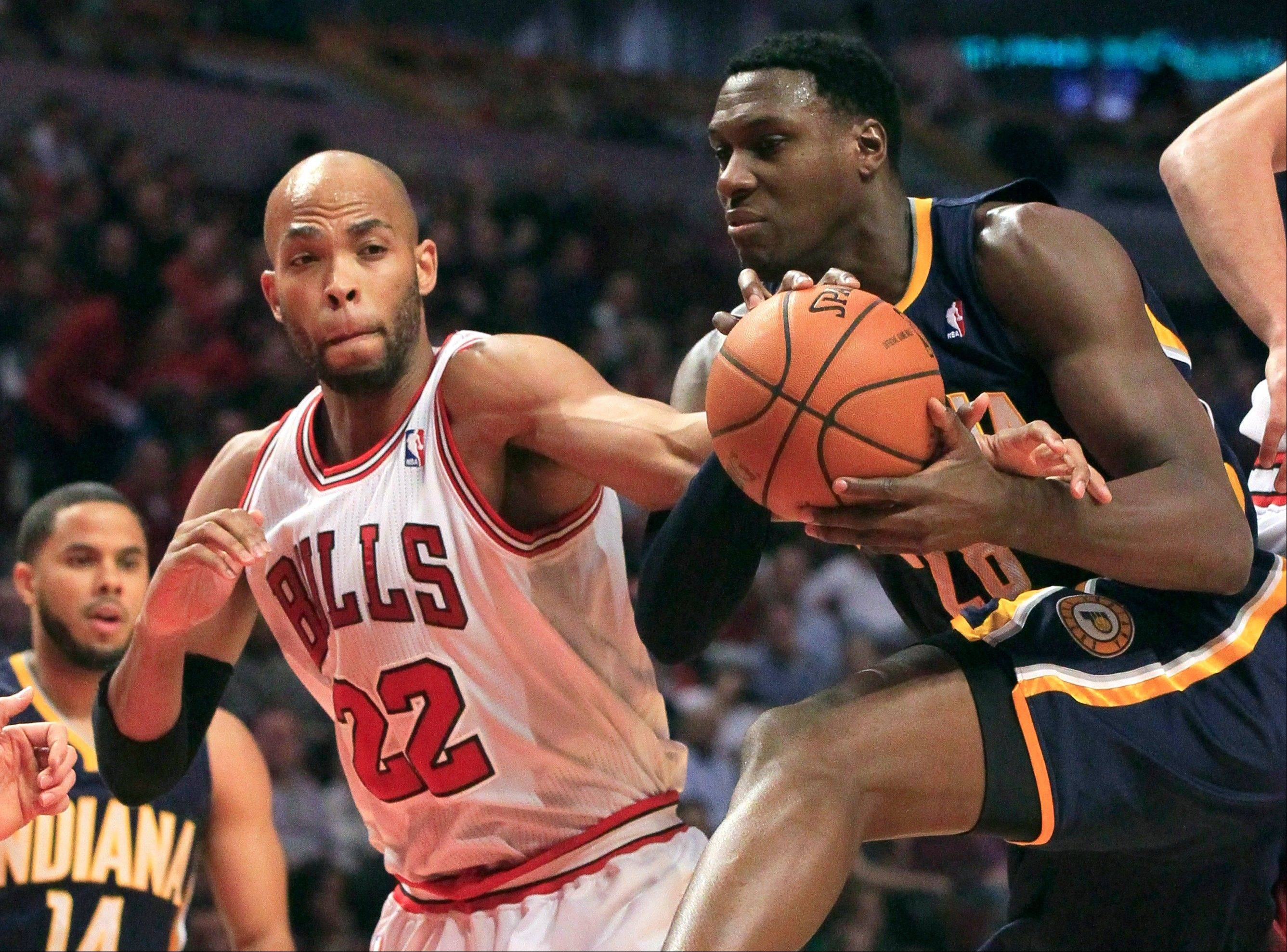 Bulls forward Taj Gibson fouls Indiana Pacers center Ian Mahinmi Tuesday during the first half at the United Center.