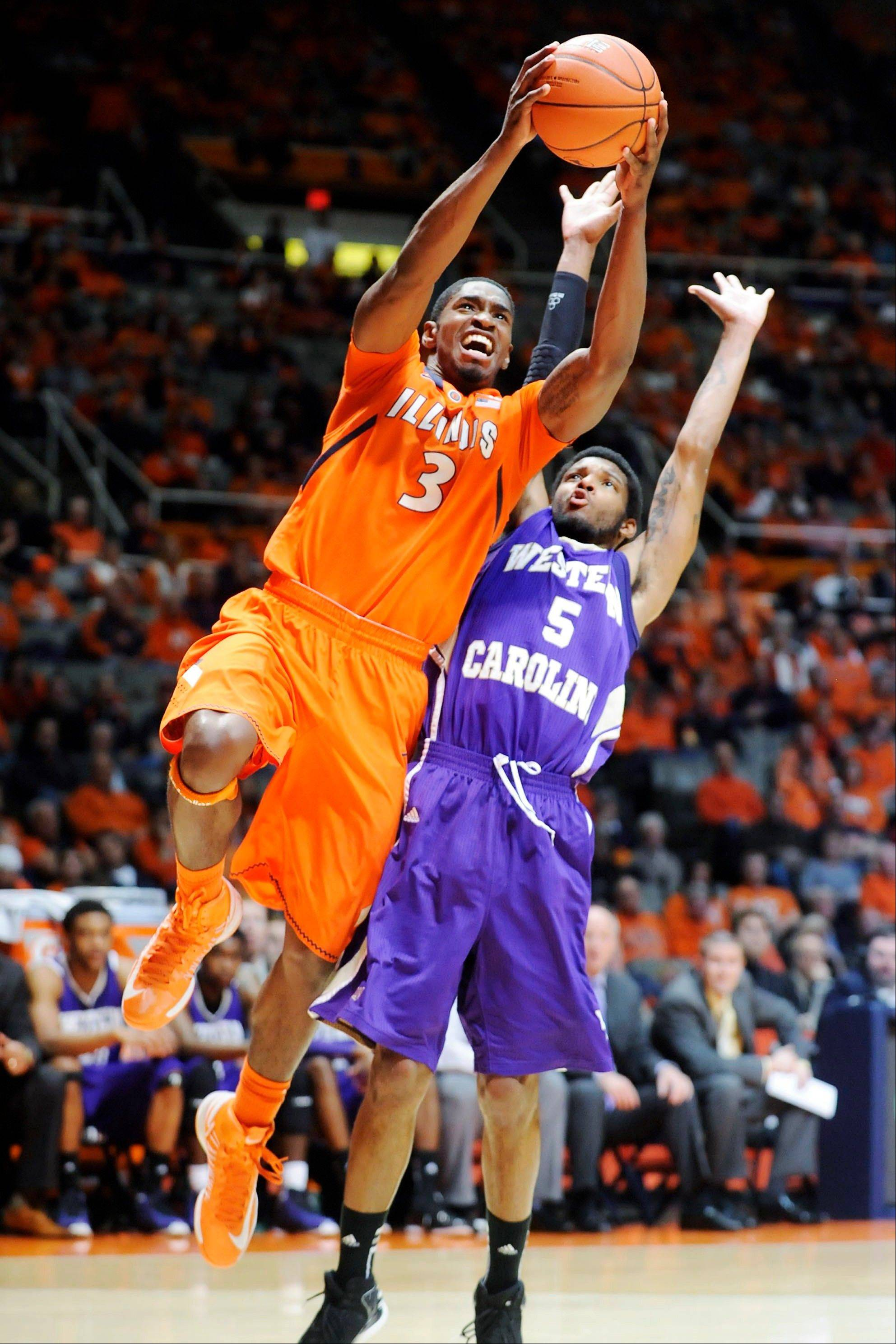 Illinois' Brandon Paul shoots against Western Carolina's Trey Sumler Tuesday during the first half in Champaign.