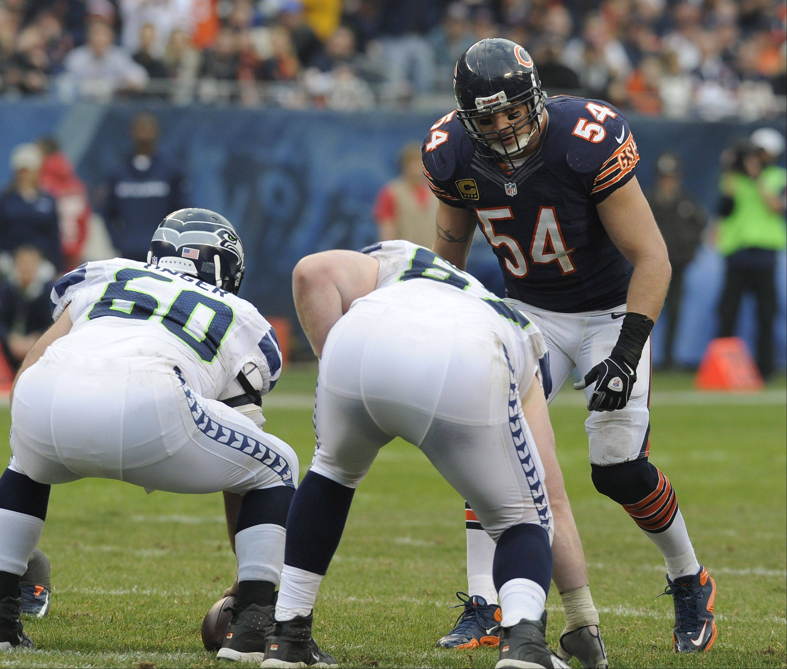 Mark Welsh/mwelsh@dailyherald.comBears Brian Urlacher on defense suffered an injury that will sideline him for the rest of the season in the Bears loss to the Seahawks at Soldier Field in Chicago.