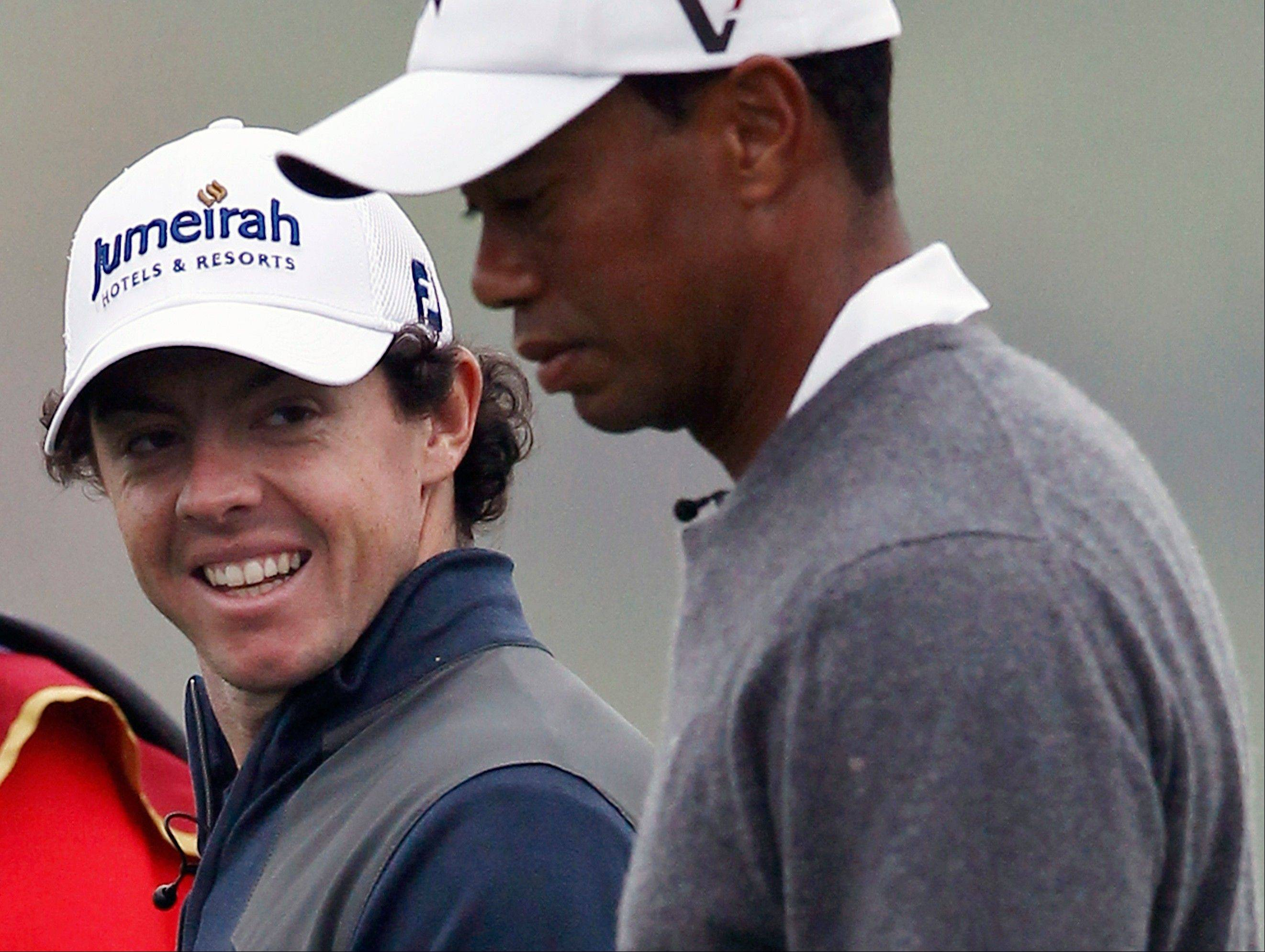 Tiger Woods, right, and Rory McIlroy walking together during their 18-hole medal-match at the Lake Jinsha Golf Club in Zhengzhou, in central China's Henan province. McIlroy was announced Tuesday as player of the year, and while the tour does not disclose the vote of its players, this was the equivalent of a tap-in.