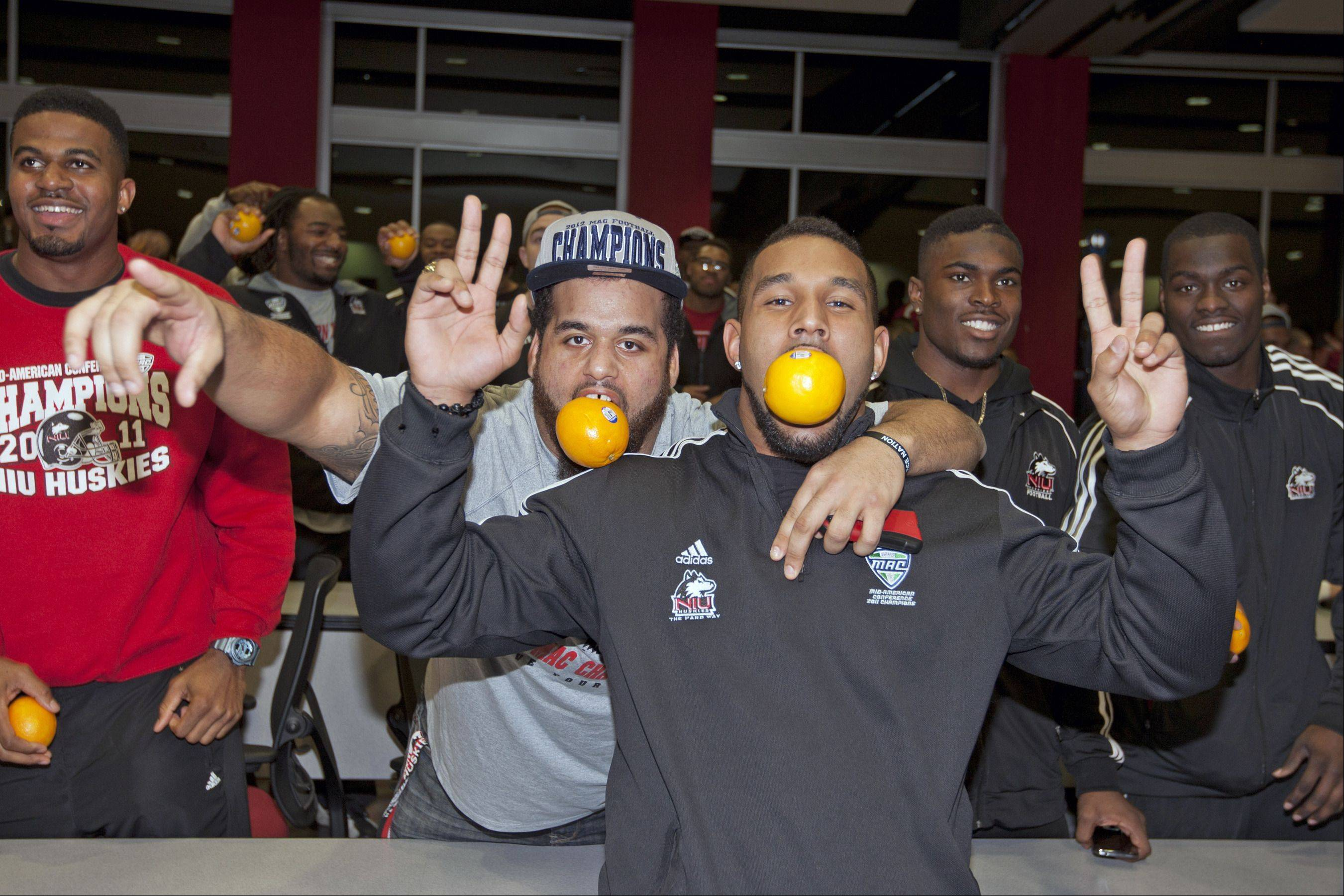 Northern Illinois football players Zach Anderson and Sean Progar celebrate after hearing that NIU will play Florida State in the Orange Bowl on New Year's Day.