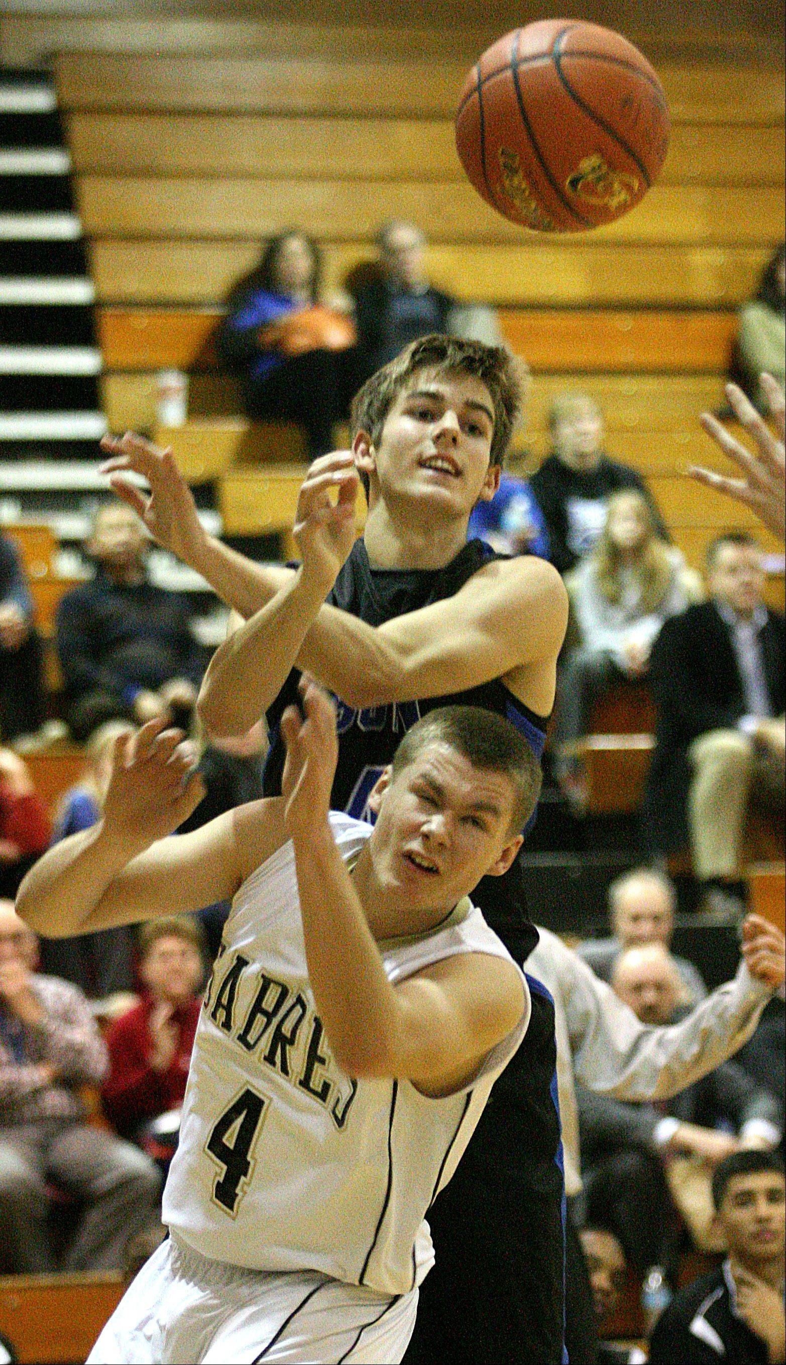 Streamwood's Jacob Siewert, bottom, and St Charles North's Jake Ludwig look for the ball during Thursday's basketball game.
