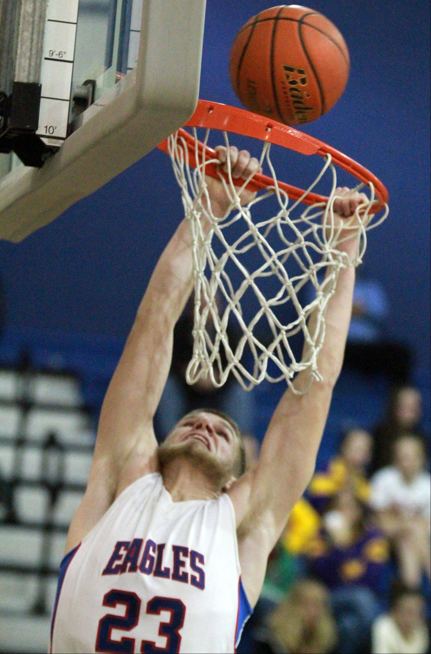Lakes' Jake Kohler attempts a breakaway dunk against Wauconda Friday in Lake Villa.