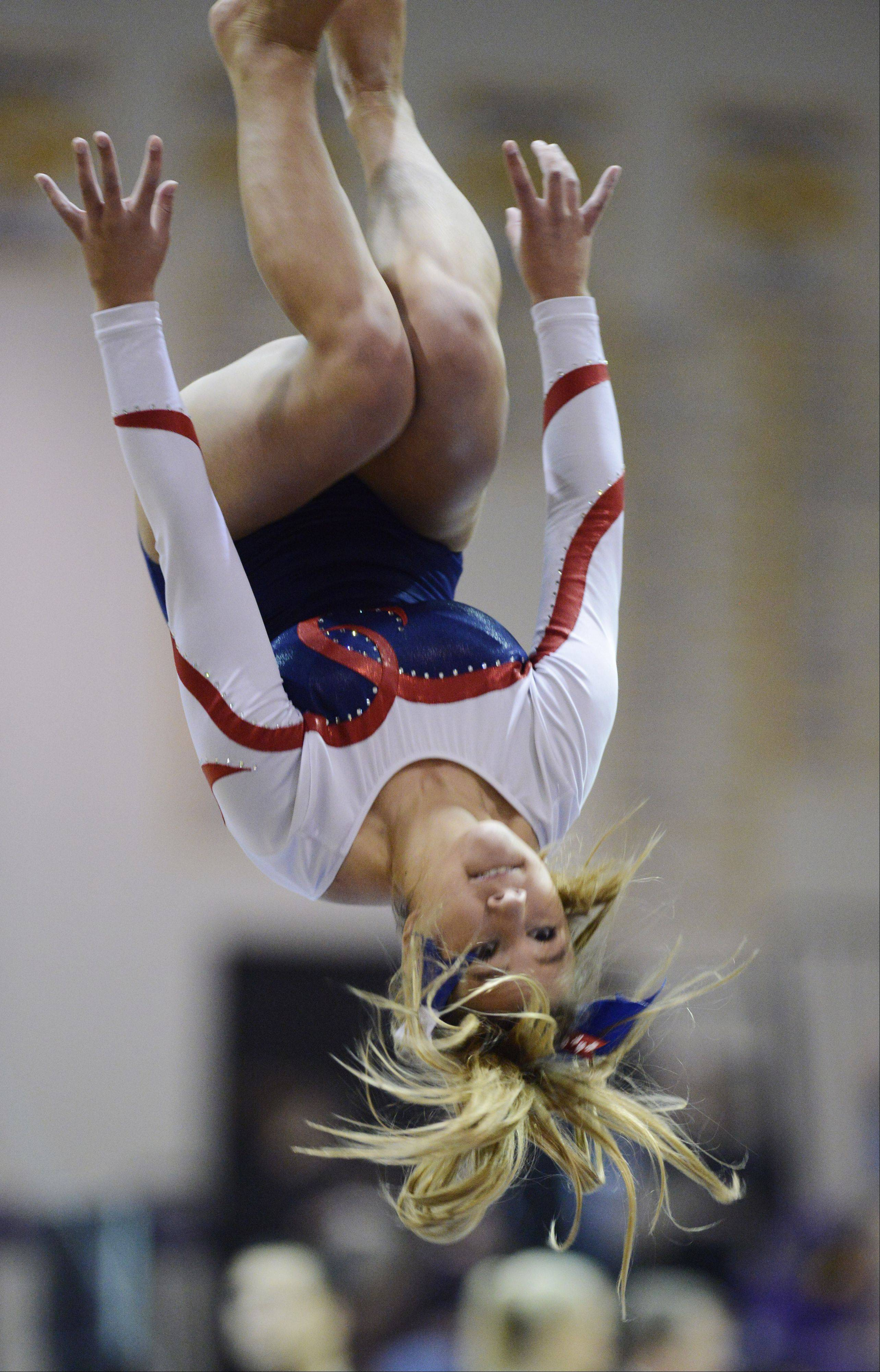Conant's Sarah Starzynski competes on the balance beam during the Al Galatte girls gymnastics invitational in Rolling Meadows Saturday.