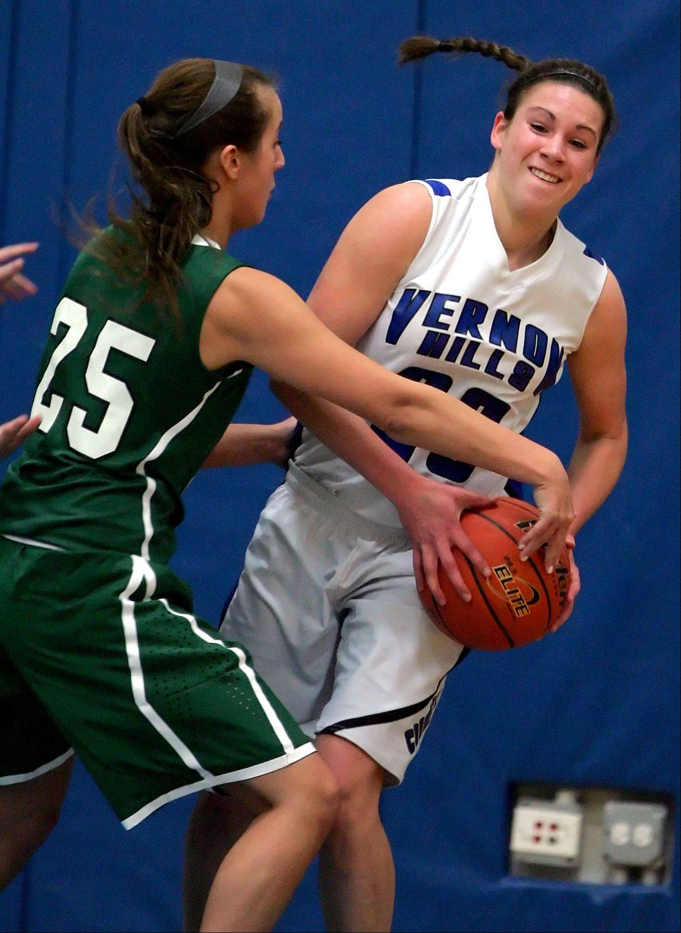 Vernon Hills' Brie Bahlmann, right, looks to pass as Grayslake Central's Taylor Peterson defends during their game Tuesday night at Vernon Hills High School.