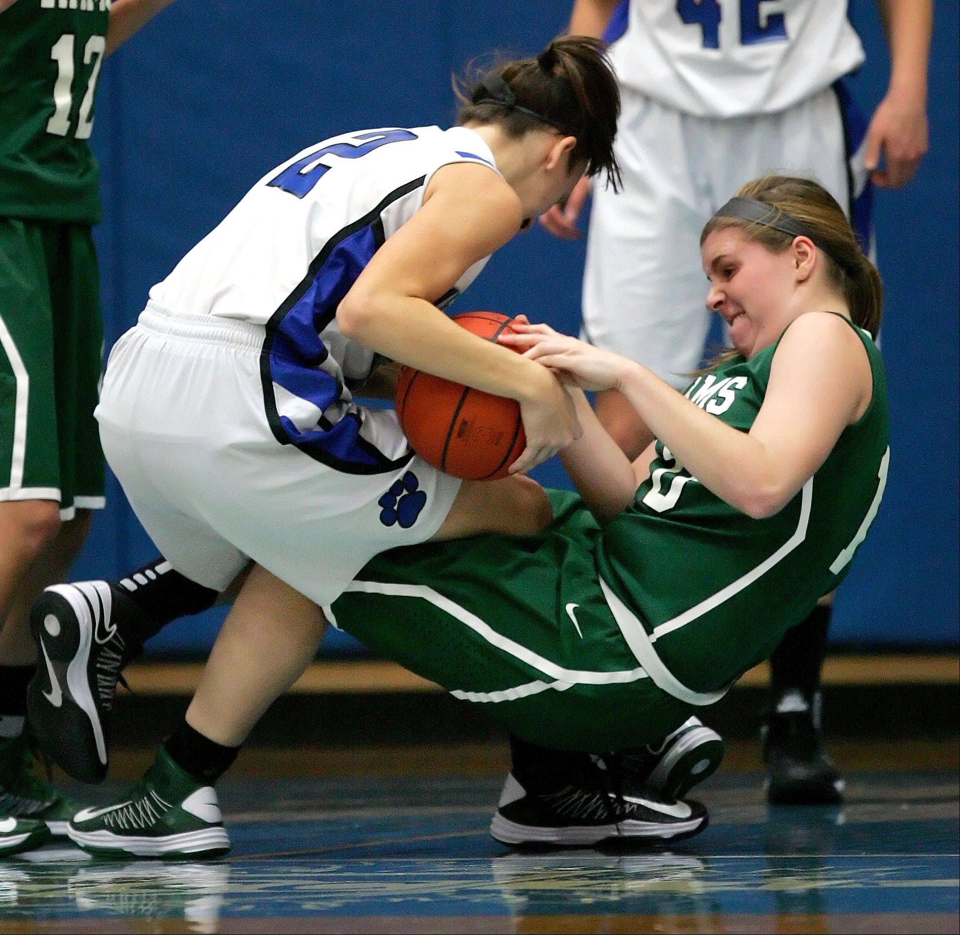 Vernon Hills' Alina Lehocky , left, and Grayslake Central's Maddy Miller fight for the ball Tuesday night in Vernon Hills.