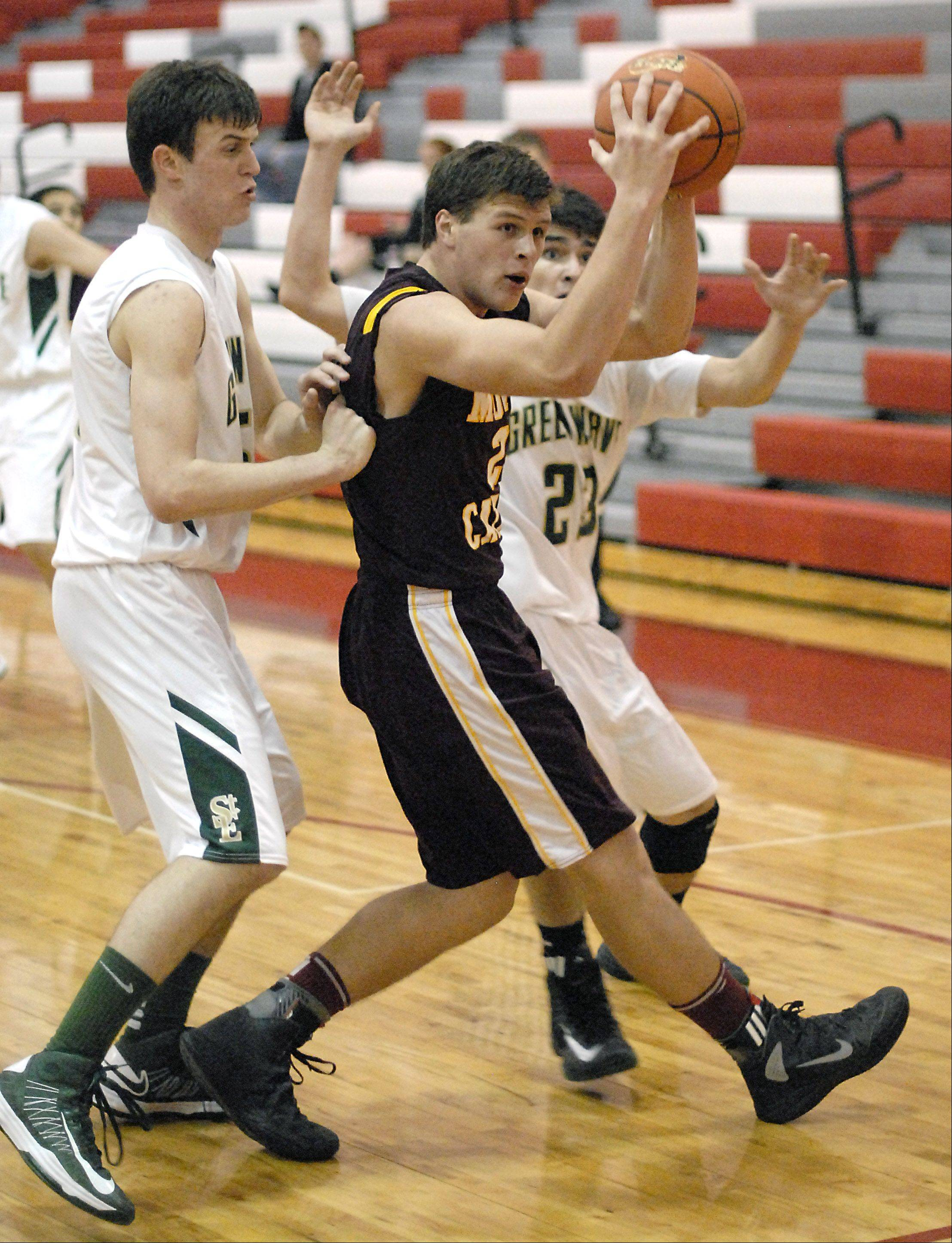 St. Edward's Nick Duffy and Danny Favela surround Montini's Matt Brachmann as he looks to pass Wednesday.
