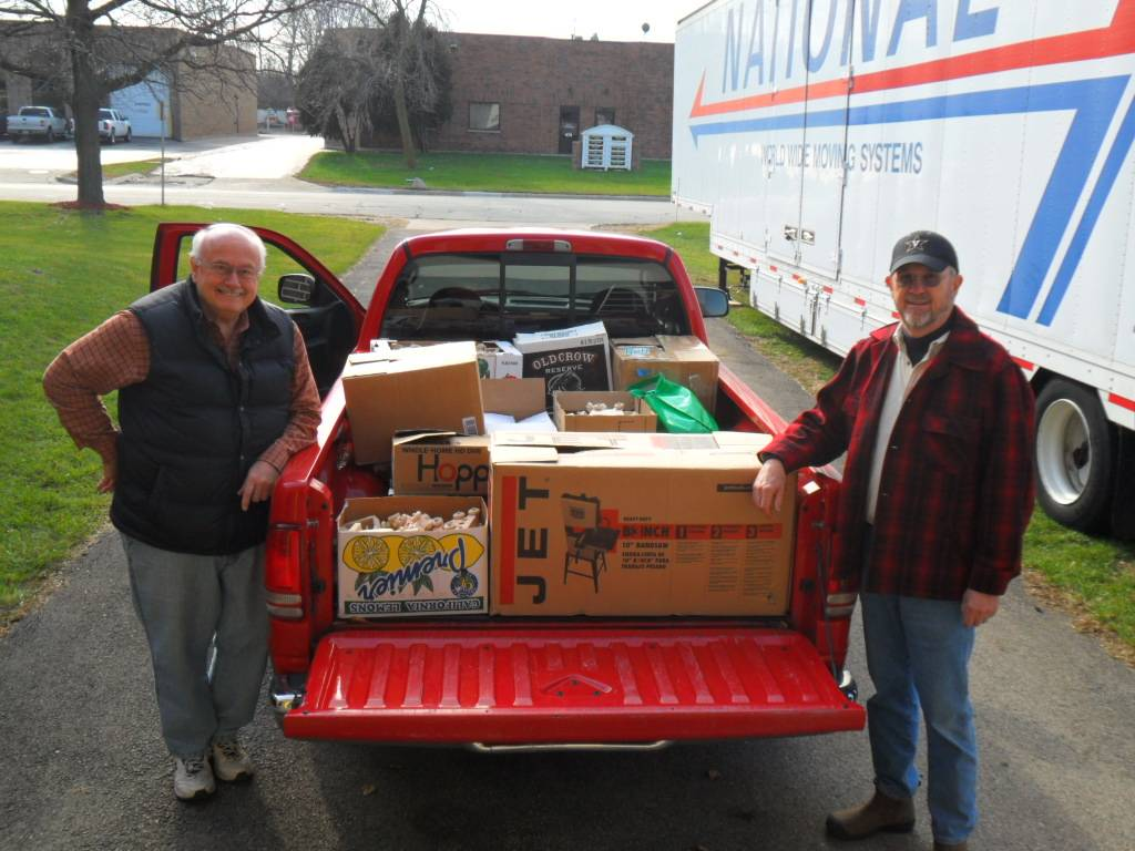 Dale Gustafson (left) and Rick Ogren (right) of the DuPage Woodworkers Club dropping off the club's donation to HSP.