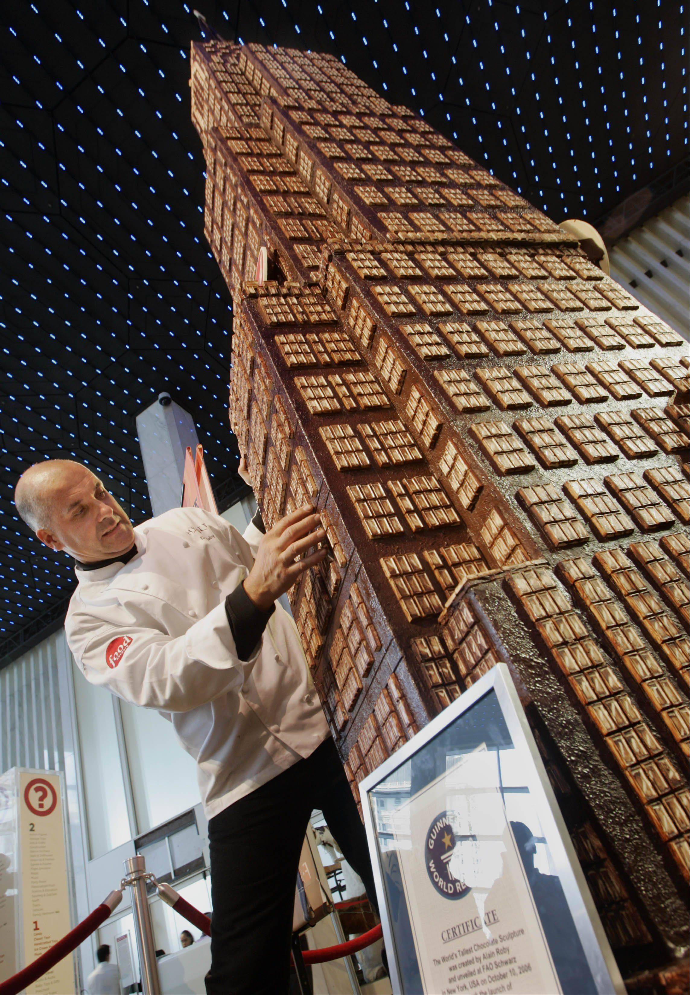 "Alain Roby, who set a new Guinness World Record for his 20-foot, 8-inch chocolate skyscraper in 2006, will go for another record on Dec. 8, the ""World's Longest Sugar Cane"" stretching 45 feet."