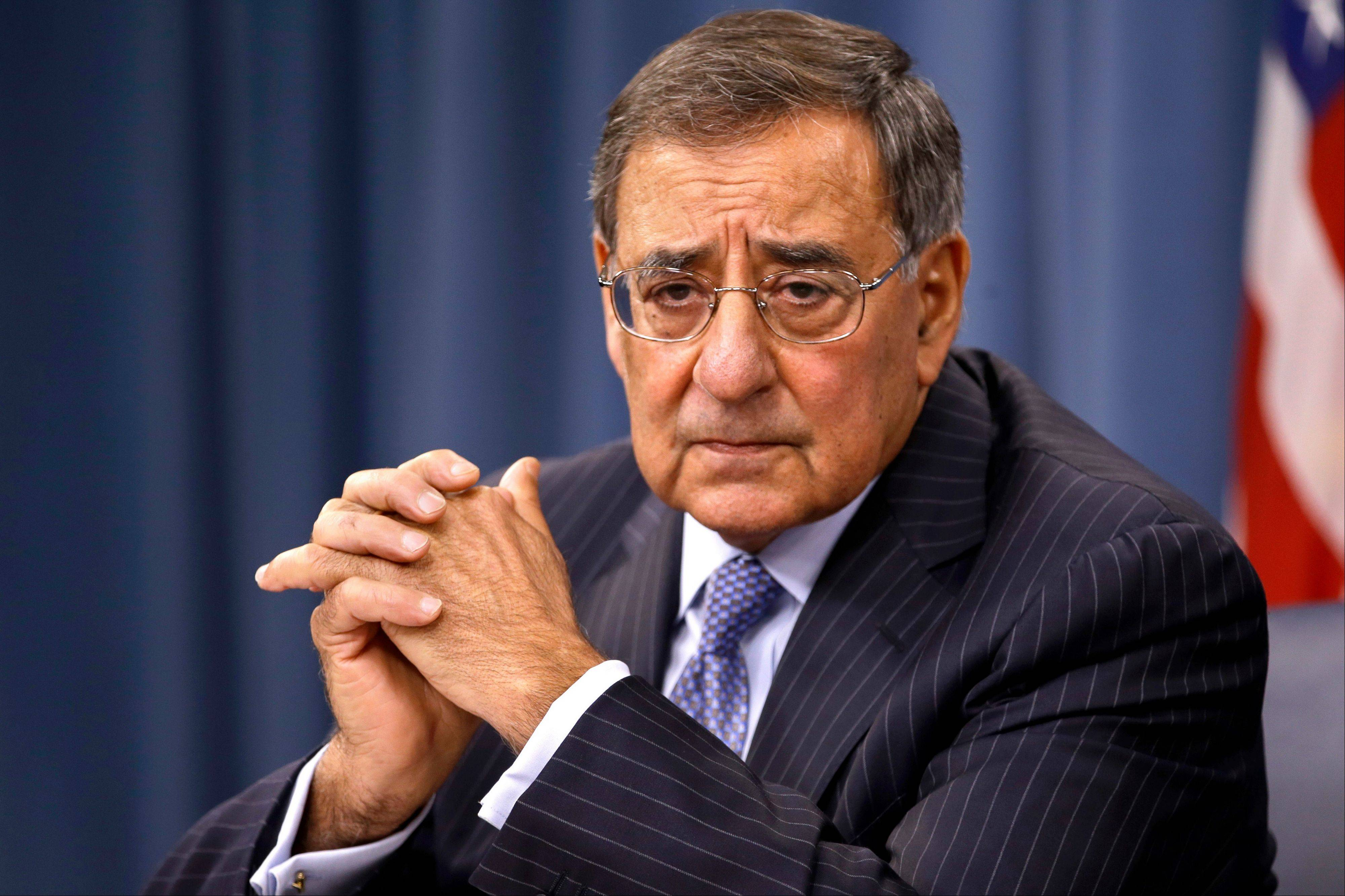 "Defense Secretary Leon Panetta listens during a news conference at the Pentagon in Washington. House Republicans' ""fiscal cliff"" counteroffer to President Barack Obama hints at billions in dollars of defense cuts on top of the $500 billion that the White House and Congress backed last year."