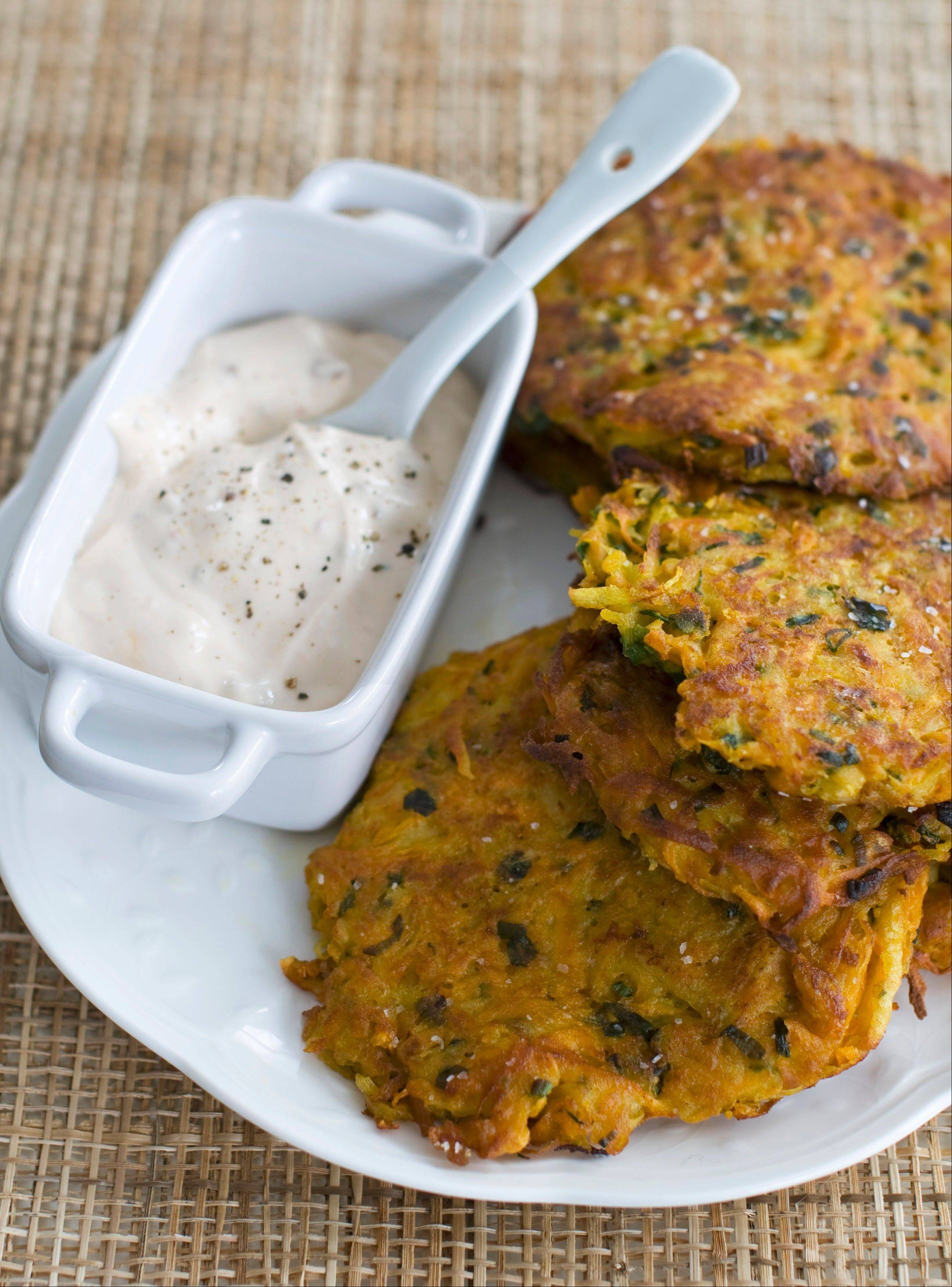 Sweet potatoes and Yukon gold go into Sara Mouton's Southwestern Latkes. She starts the potato patties in a fry pan and finishes them in the oven.