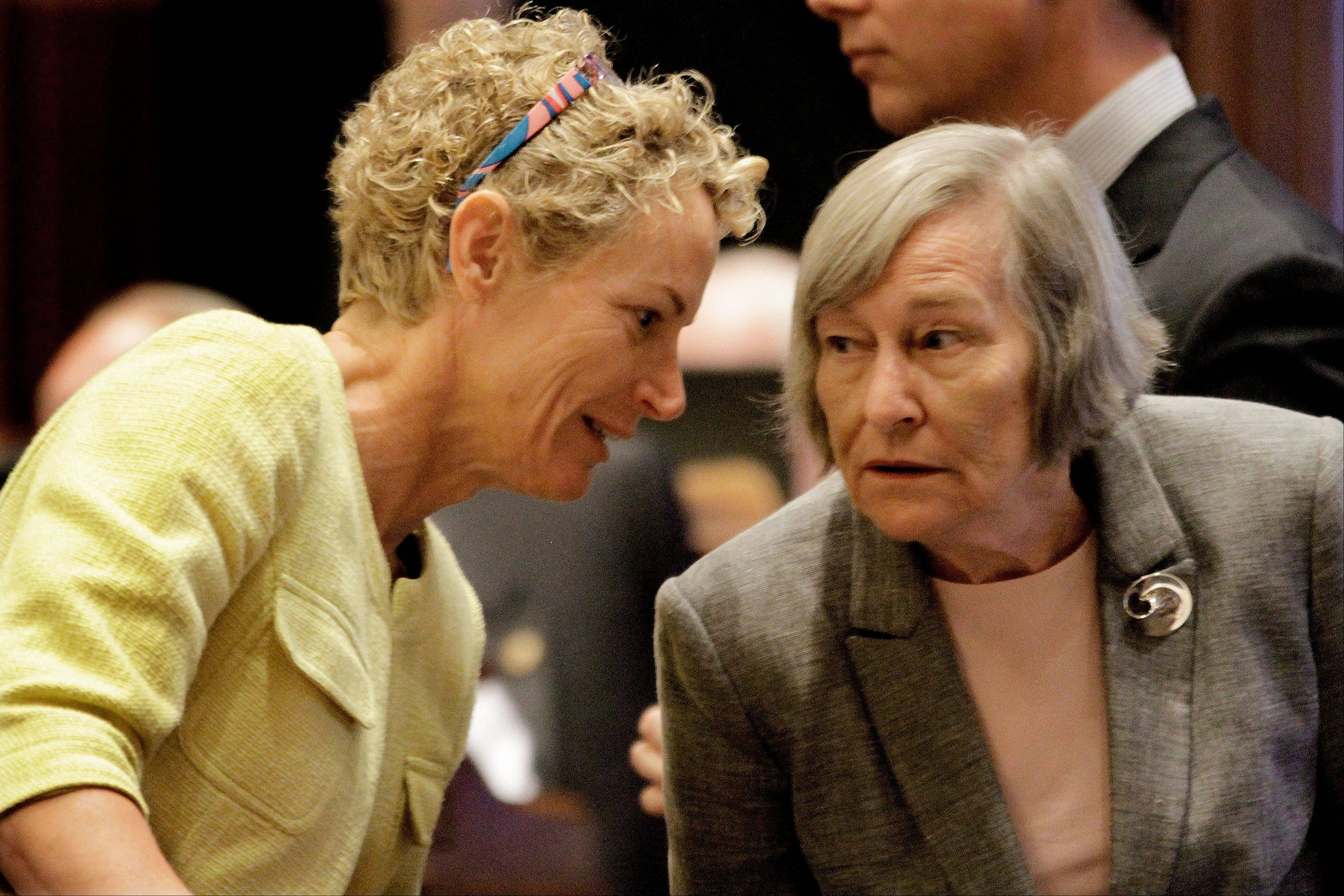 Democratic state Reps. Elaine Nekritz of Northbrook, left, and Barbara Flynn Currie of Chicago confer at the Illinois Capitol this summer as lawmakers considered how to tackle the state�s rising pension costs.