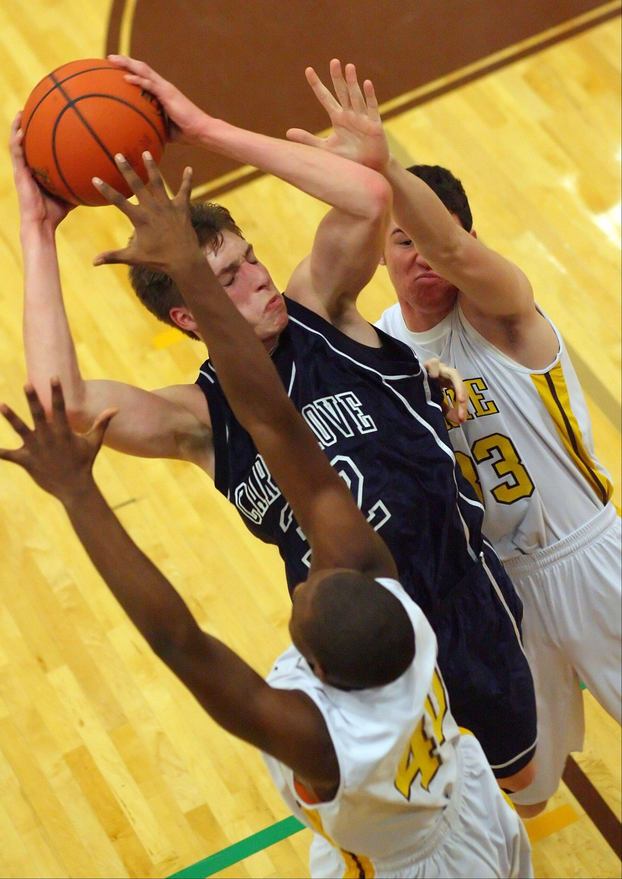 Cary-Grove�s Dean Lee, center, drives on Carmel�s Chris Duff, left, and Matt Kelly on Wednesday night at Carmel.