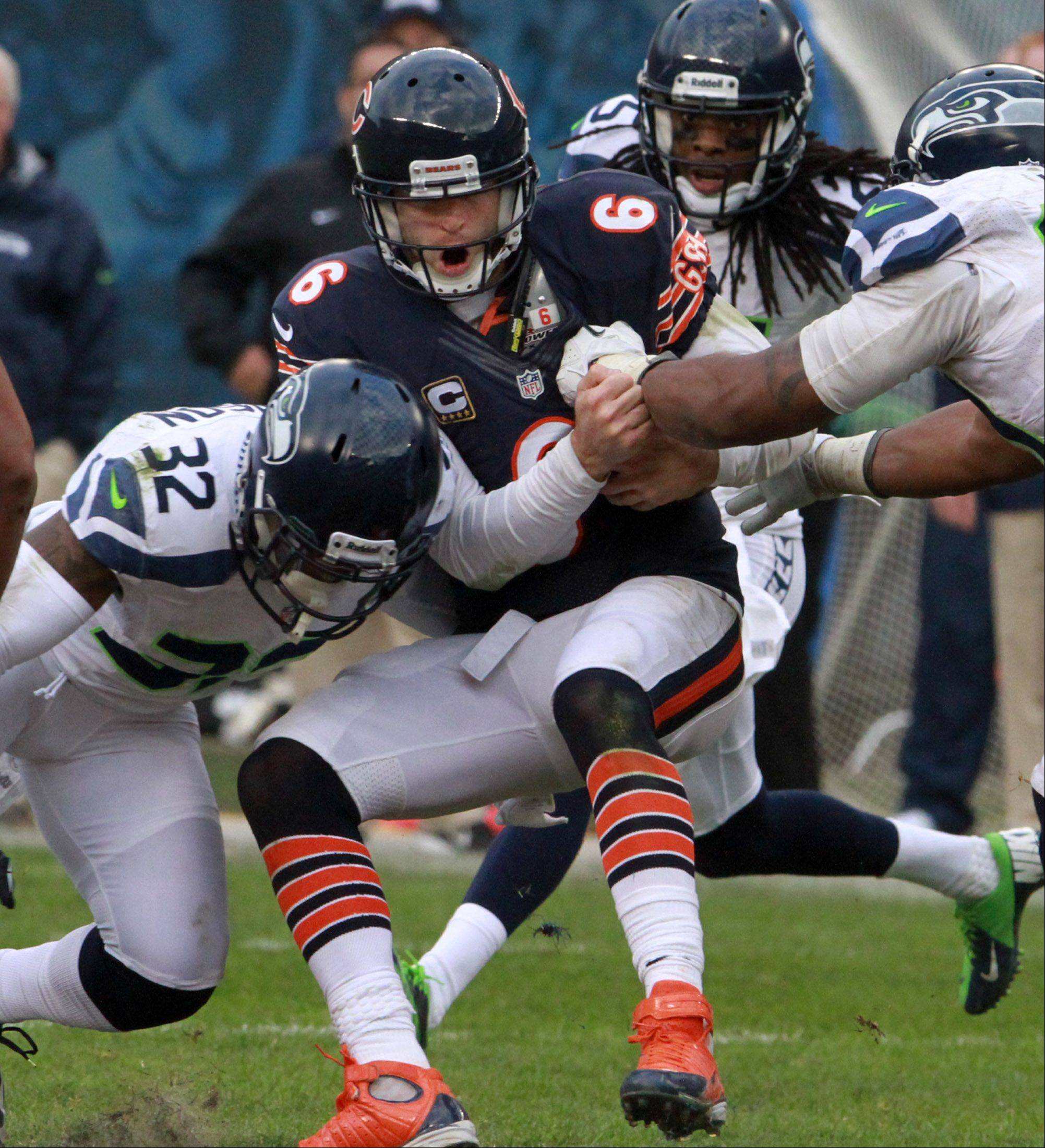 Bears quarterback Jay Cutler, here being tackled after taking off on a run, says his offensive line is �playing better.�