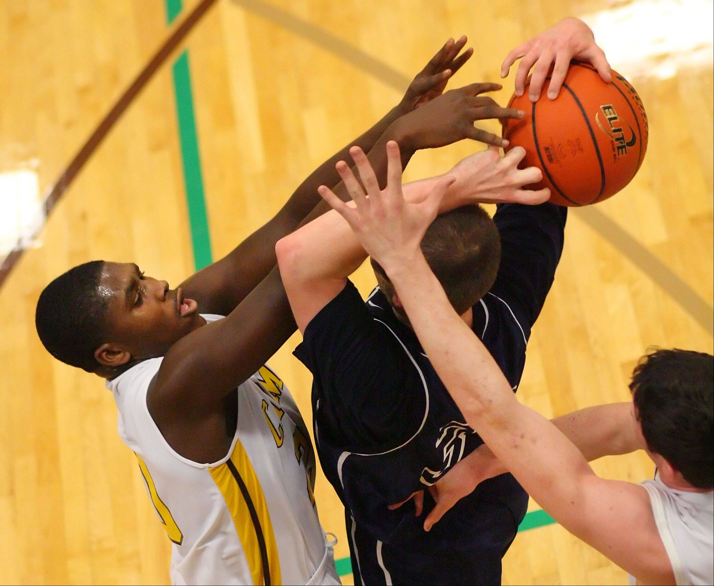 Carmel�s Nickai Poyser, left, pressures Cary-Grove�s Steve Plazak.
