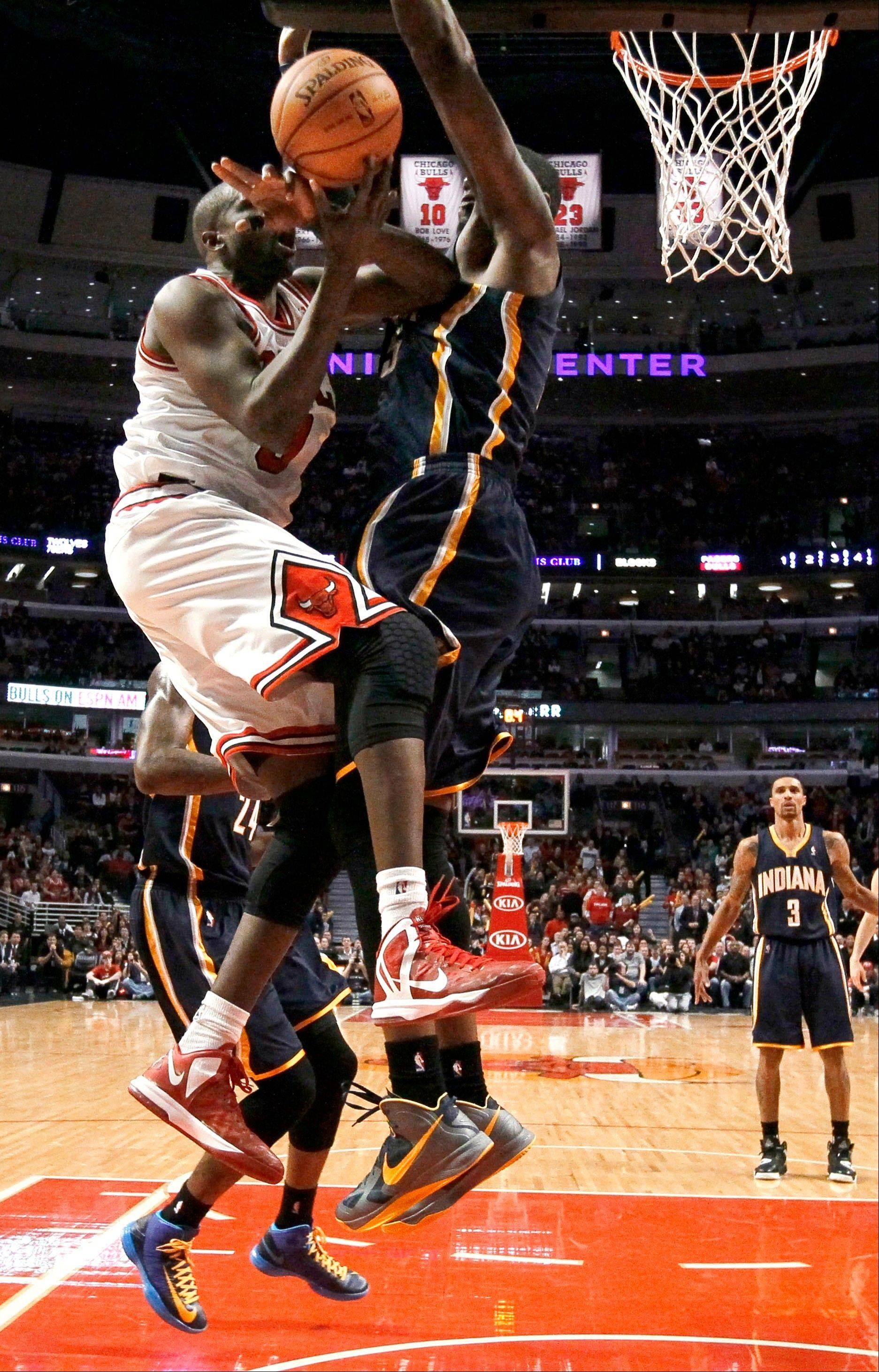 Pacers center Roy Hibbert blocks the path to the basket for the Bulls� Luol Deng, without a fouled called, during the final seconds of Tuesday night�s game at the United Center.