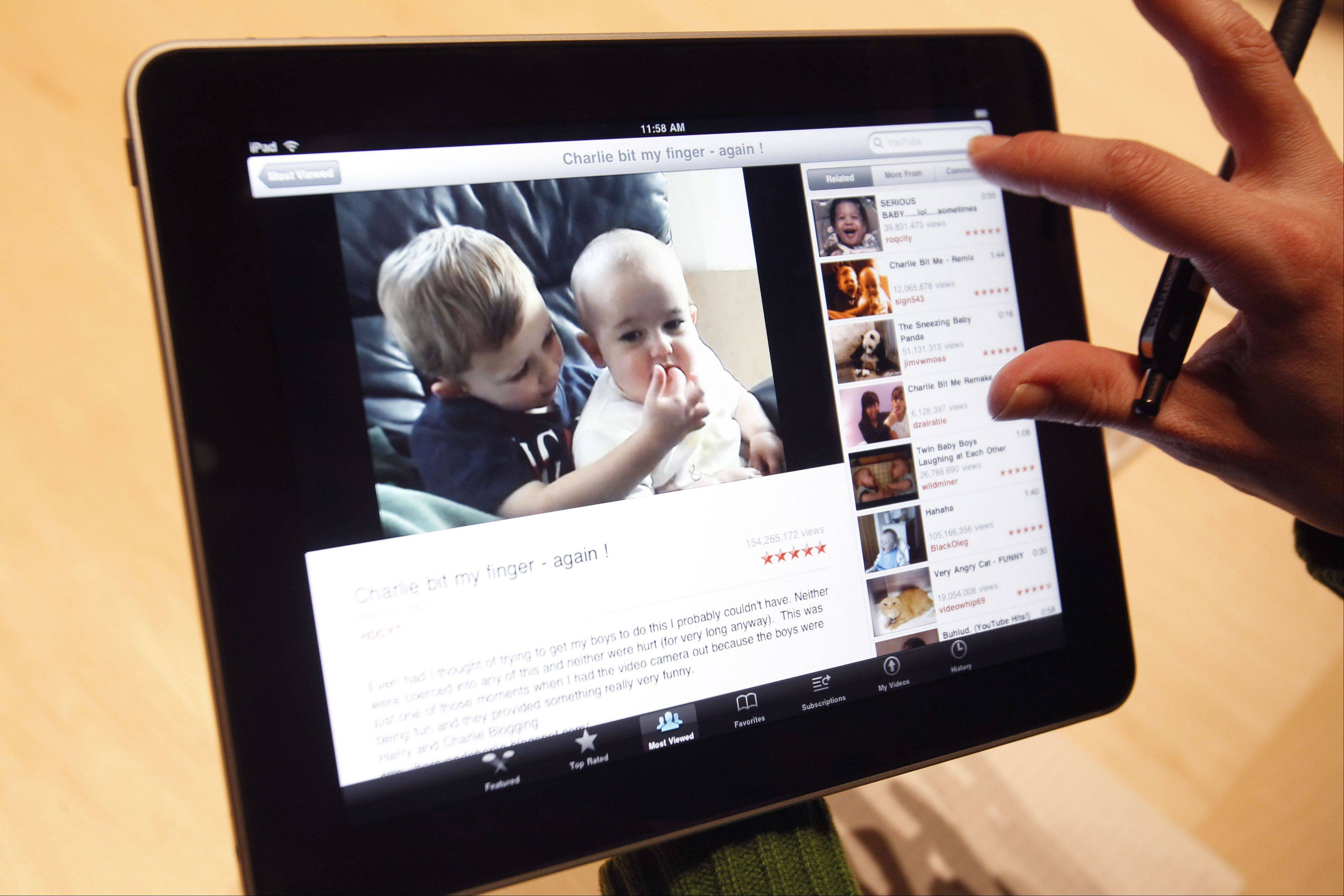 ASSOCIATED PRESSApple stock slid Wednesday, in part over concerns the iPad was losing market share in the tablet battle.