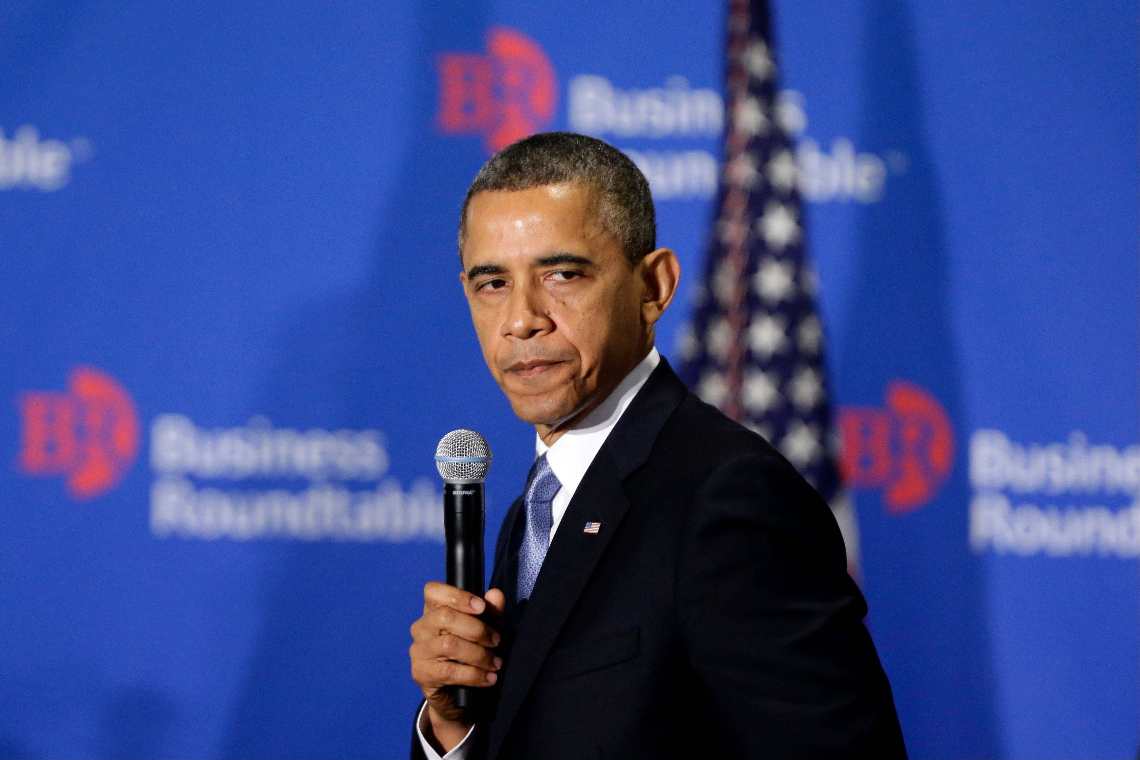 "President Barack Obama pauses as he speaks about the fiscal cliff at the Business Roundtable, an association of chief executive officers, in Washington, Wednesday, Dec. 5, 2012. The president warned Republicans not to create another fight over the nation's debt ceiling, telling business leaders it's ""not a game that I will play."""