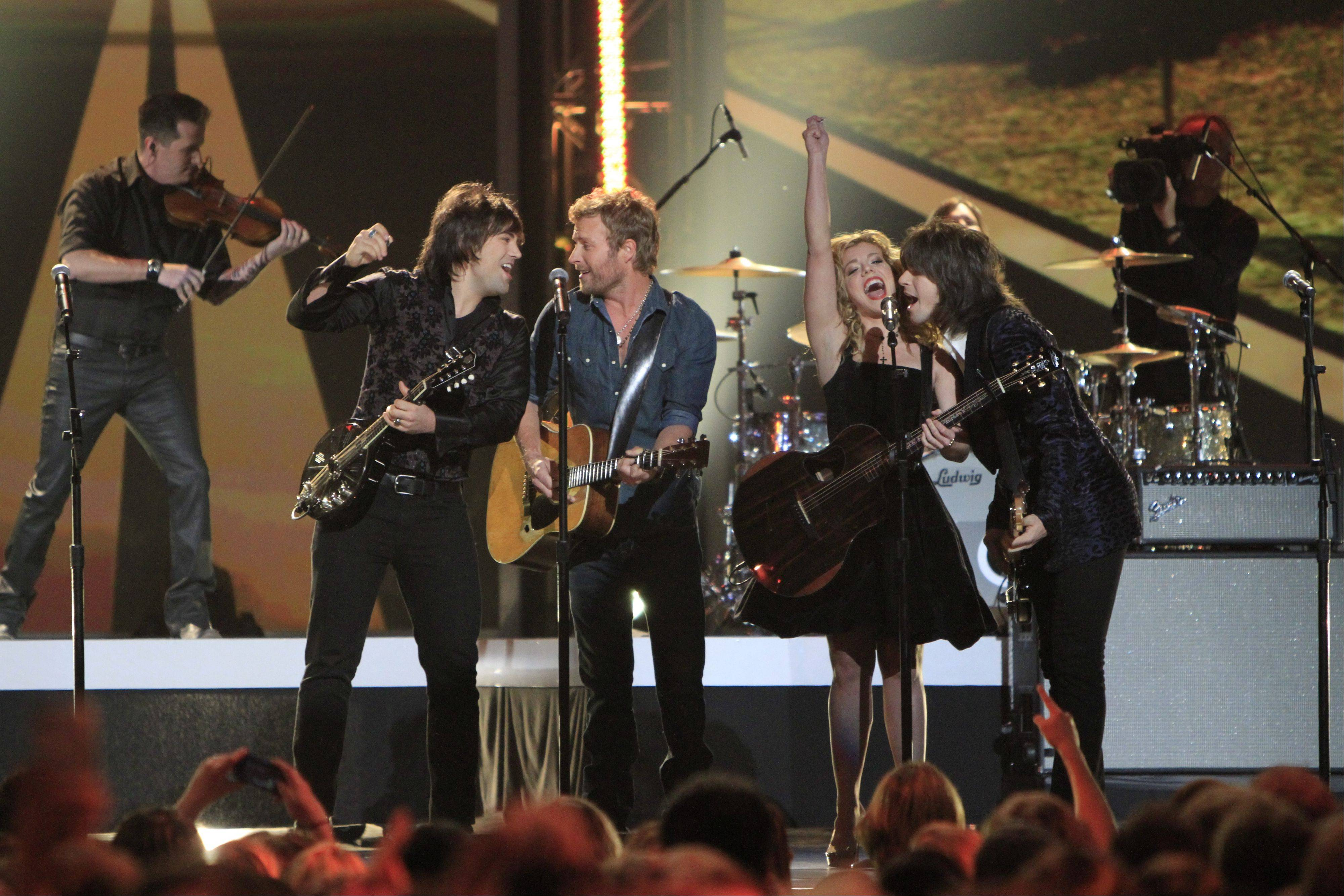 Dierks Bentley, second from left, and from left, Neil Perry, Kimberly Perry and Reid Perry, of The Band Perry, perform at the Grammy Nominations Concert Live! at Bridgestone Arena on Wednesday night in Nashville.