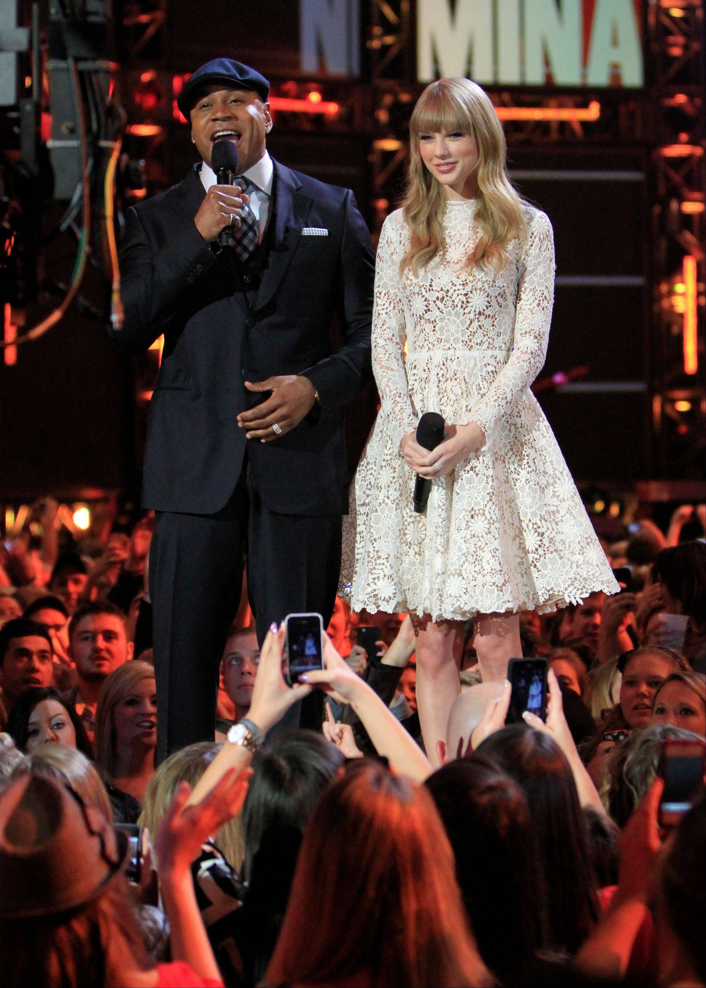 Hosts LL Cool J and Taylor Swift speak during the Grammy Nominations Concert Live! Wednesday night at Bridgestone Arena in Nashville.