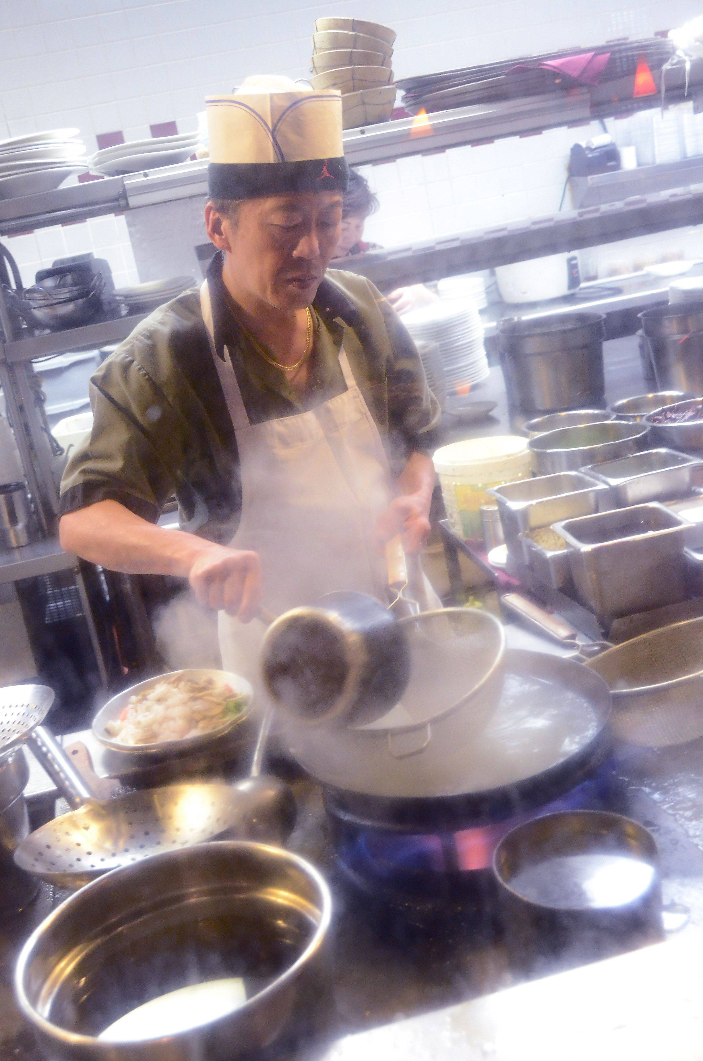 Diners at Yu's Mandarin can peer into the kitchen and watch chefs prepare their meal.