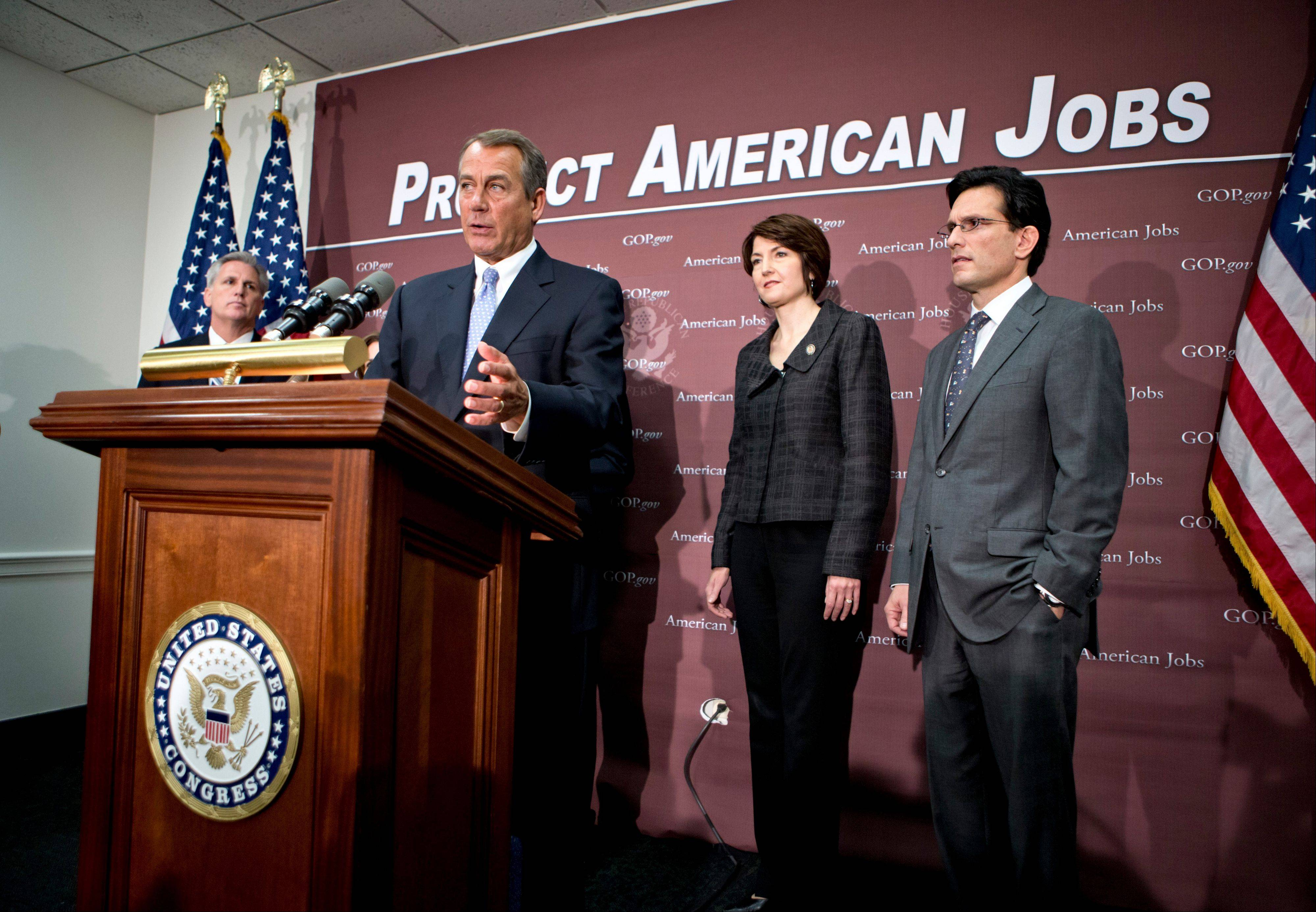 House Speaker John Boehner of Ohio, accompanied by the House GOP leadership, speaks to reporters on Capitol Hill Wednesday, following a closed-door GOP strategy session. From left are, House Majority Whip Kevin McCarthy of California, Boehner, Rep. Cathy McMorris Rodgers, a Washington Republican, and House Majority Leader Eric Cantor of Virginia.