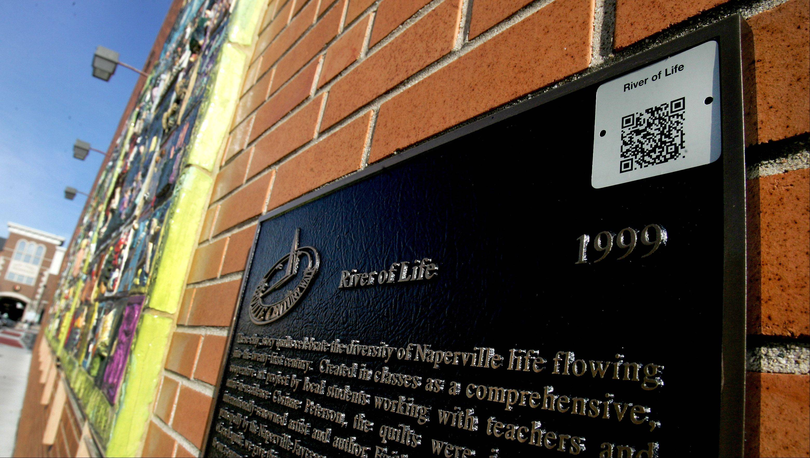 All of Naperville's Century Walk public art pieces now have QR codes that lead you to audio clips about the pieces.