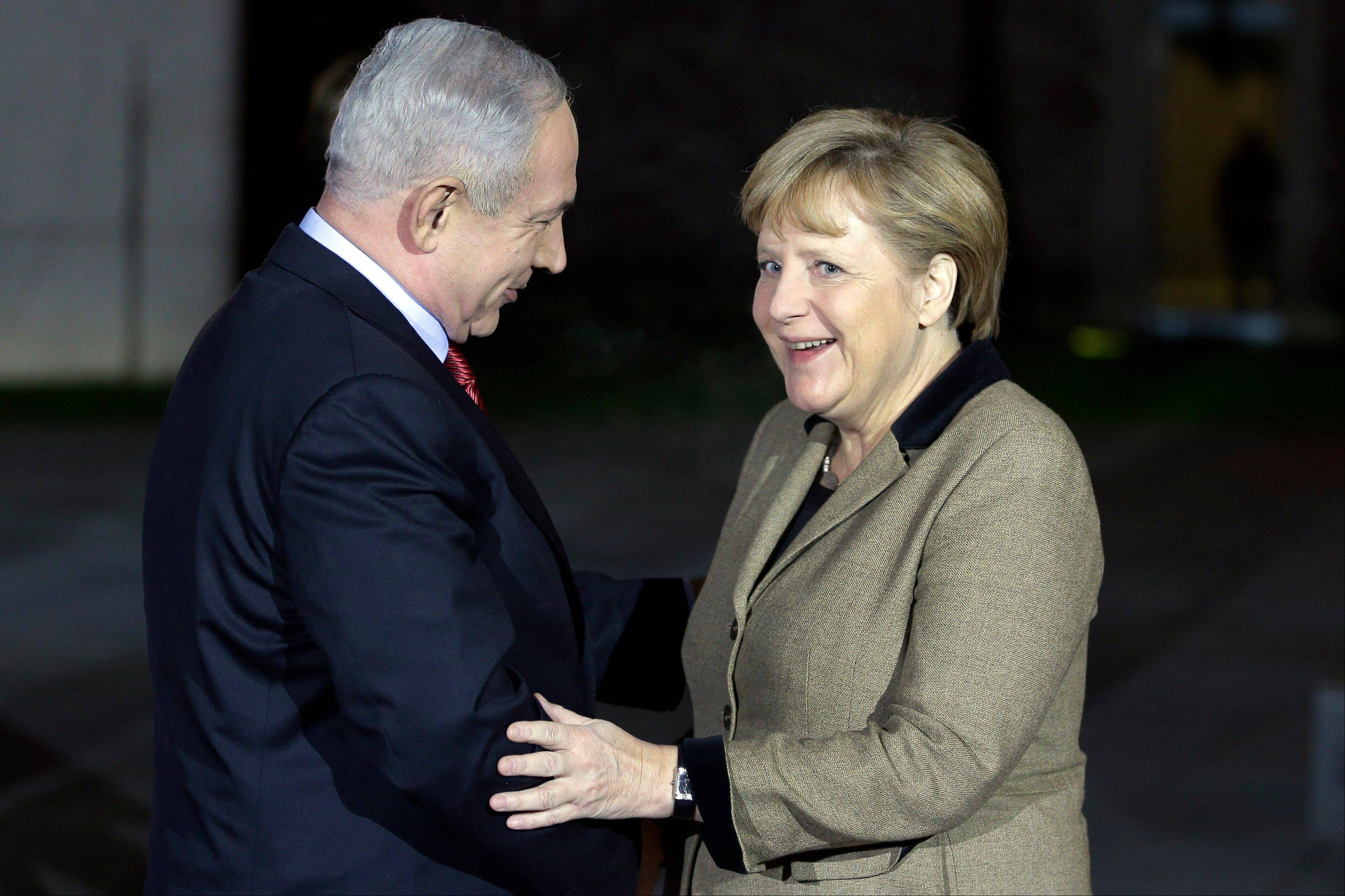 German Chancellor Angela Merkel, right, welcomes the Prime Minister of Israel, Benjamin Netanjahu, in front of the chancellery in Berlin, Germany, Wednesday for a joint dinner prior to intergovernmental talks on Thursday.