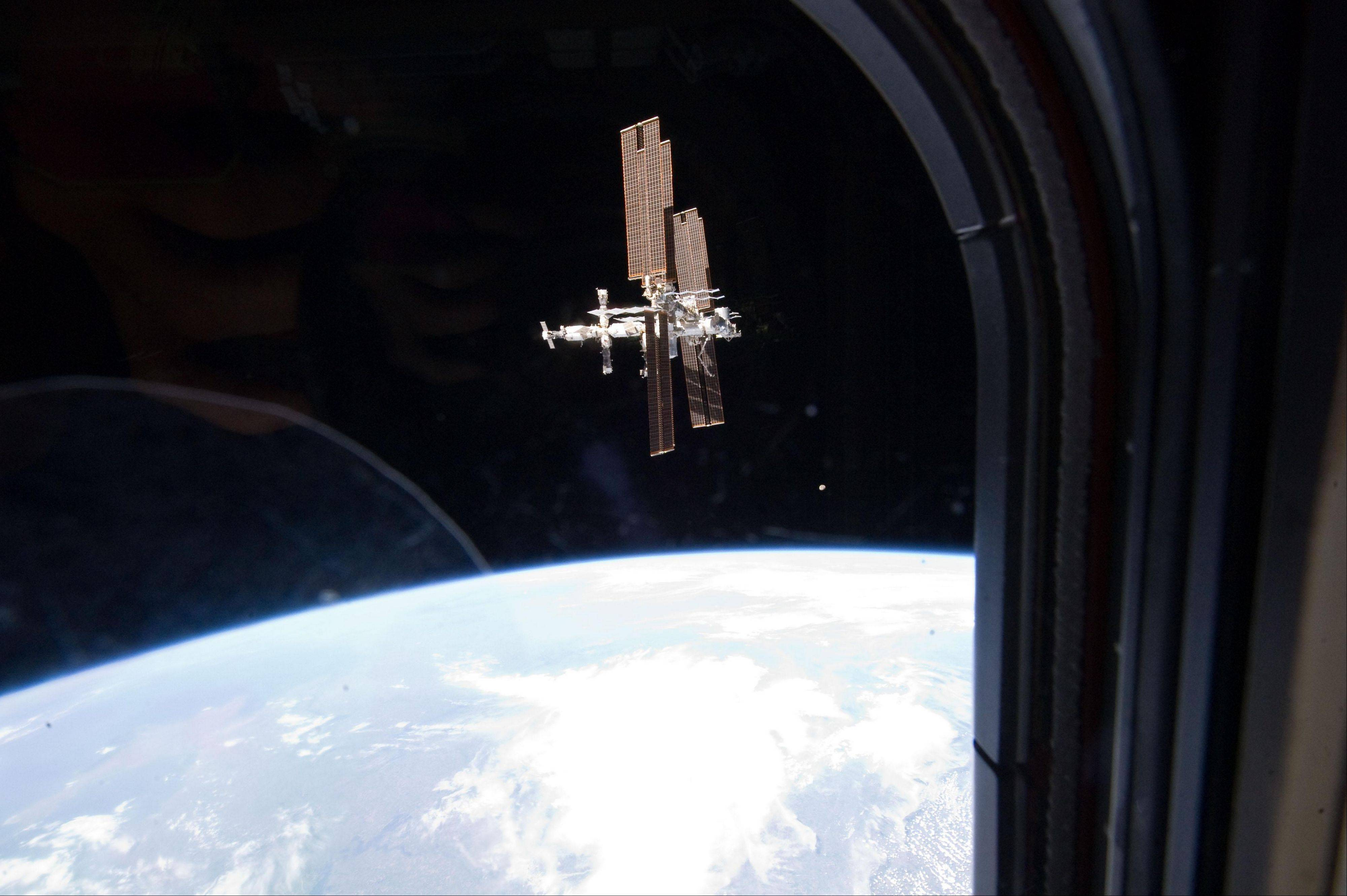 This July 19, 2011, image shows the International Space Station photographed by a member of Atlantis' STS-135 crew during a fly around as the shuttle departed the station on the last space shuttle mission.