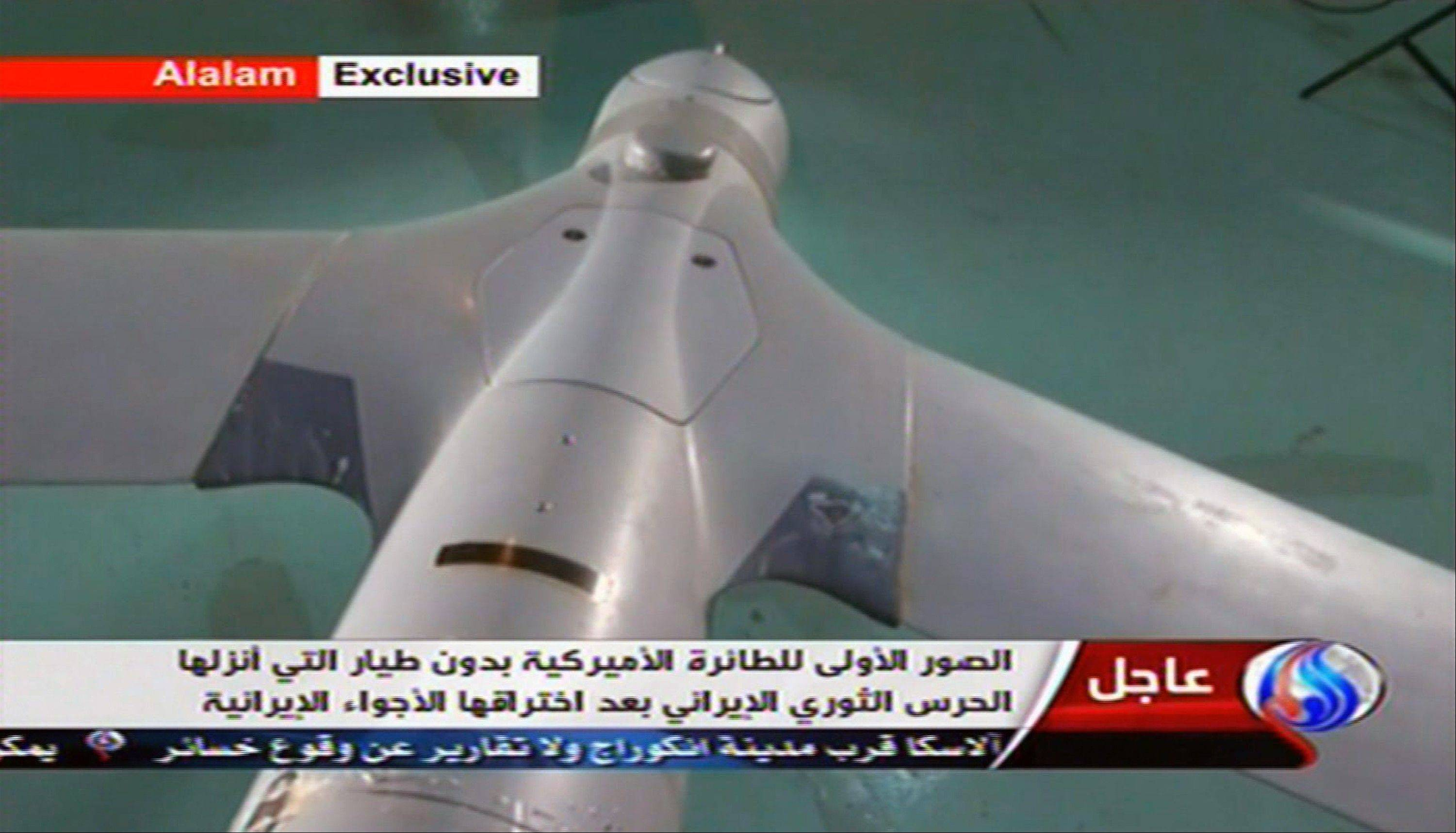 "This image taken from the Iranian state TV's Arabic-language channel Al-Alam shows what they purport to be an intact U.S. drone aircraft captured after it entered Iranian airspace over the Persian Gulf. The U.S. Navy said all its unmanned aircraft in the region were ""fully accounted for,"" but a prominent lawmaker in Tehran said Wednesday Iran has material evidence to prove that it has captured an American unmanned aircraft."