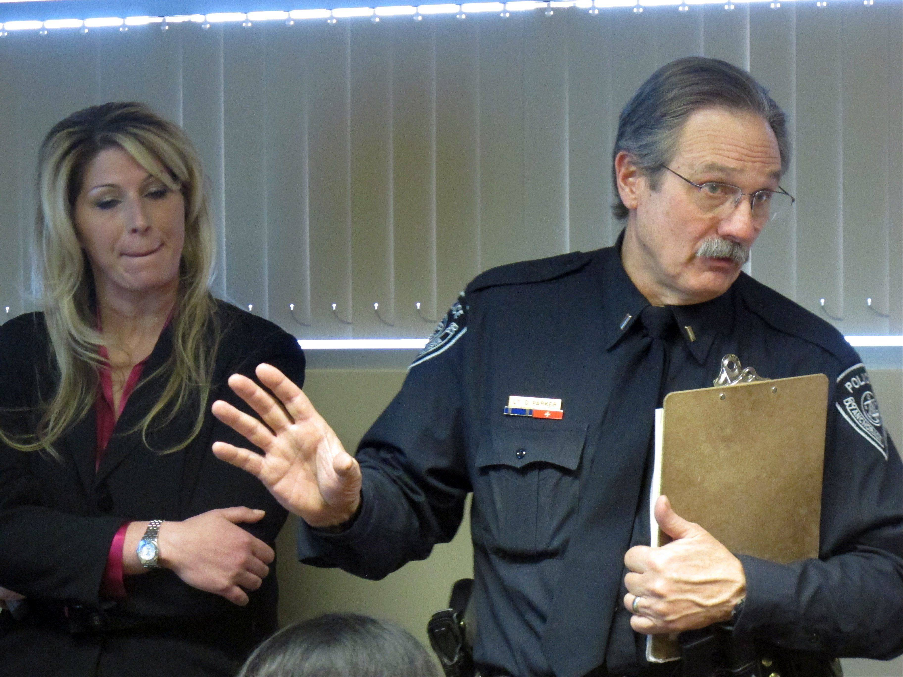 Anchorage Police Detective Monique Doll, left, and spokesman Lt. Dave Parker speak Tuesday during a news conference in Anchorage, Alaska. Authorities released more information of the Feb. 1, 2012, abduction of Samantha Koenig, 18, from a coffee stand in Anchorage.
