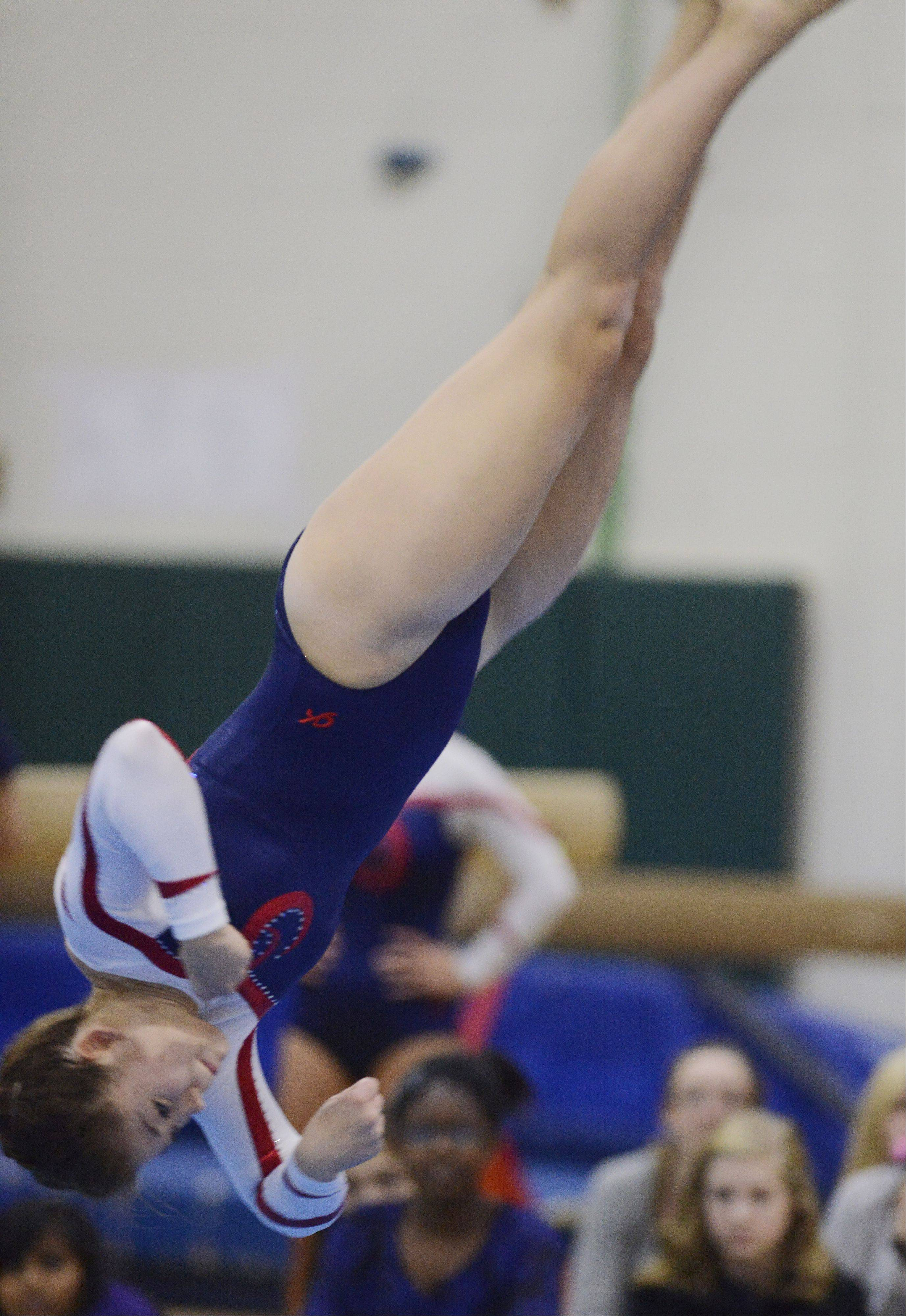 Conant's Meicie Bennett competes on the floor exercise during Wednesday's meet at Fremd.