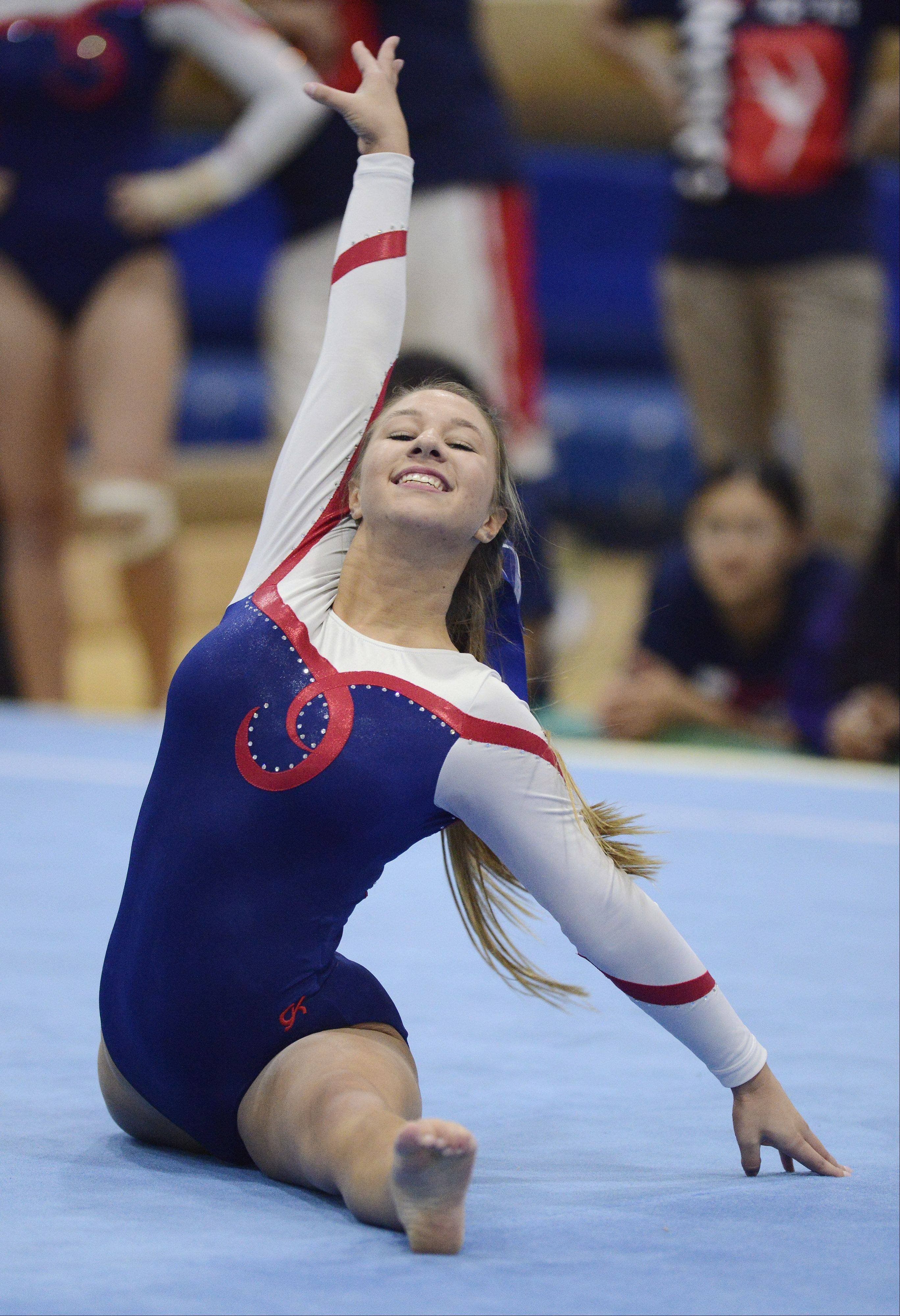 Conant's Sarah Starzynski competes on the floor exercise during Wednesday's meet at Fremd.
