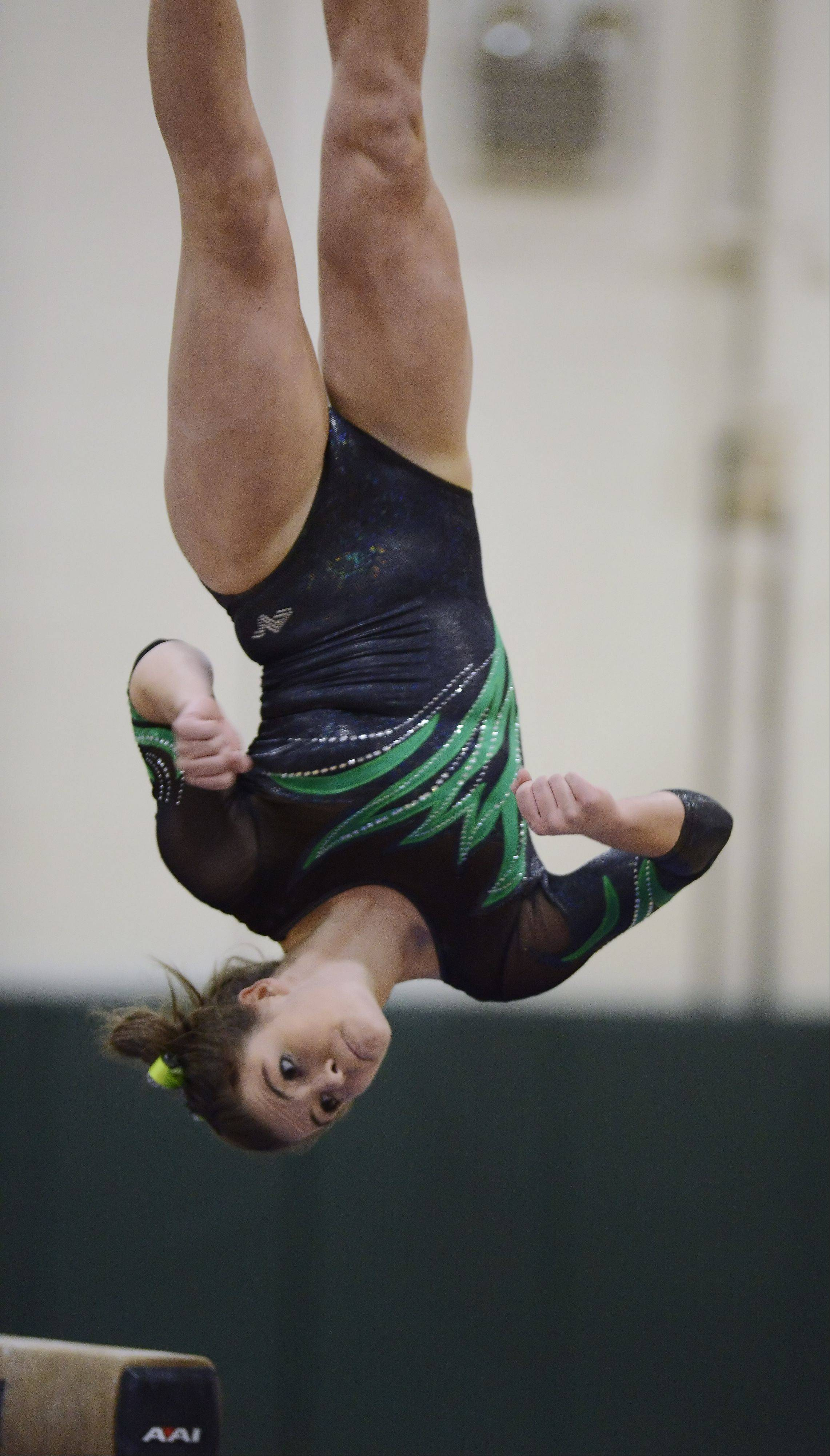 Fremd's Christine Jensen dismounts from the balance beam during Wednesday's meet with Conant.