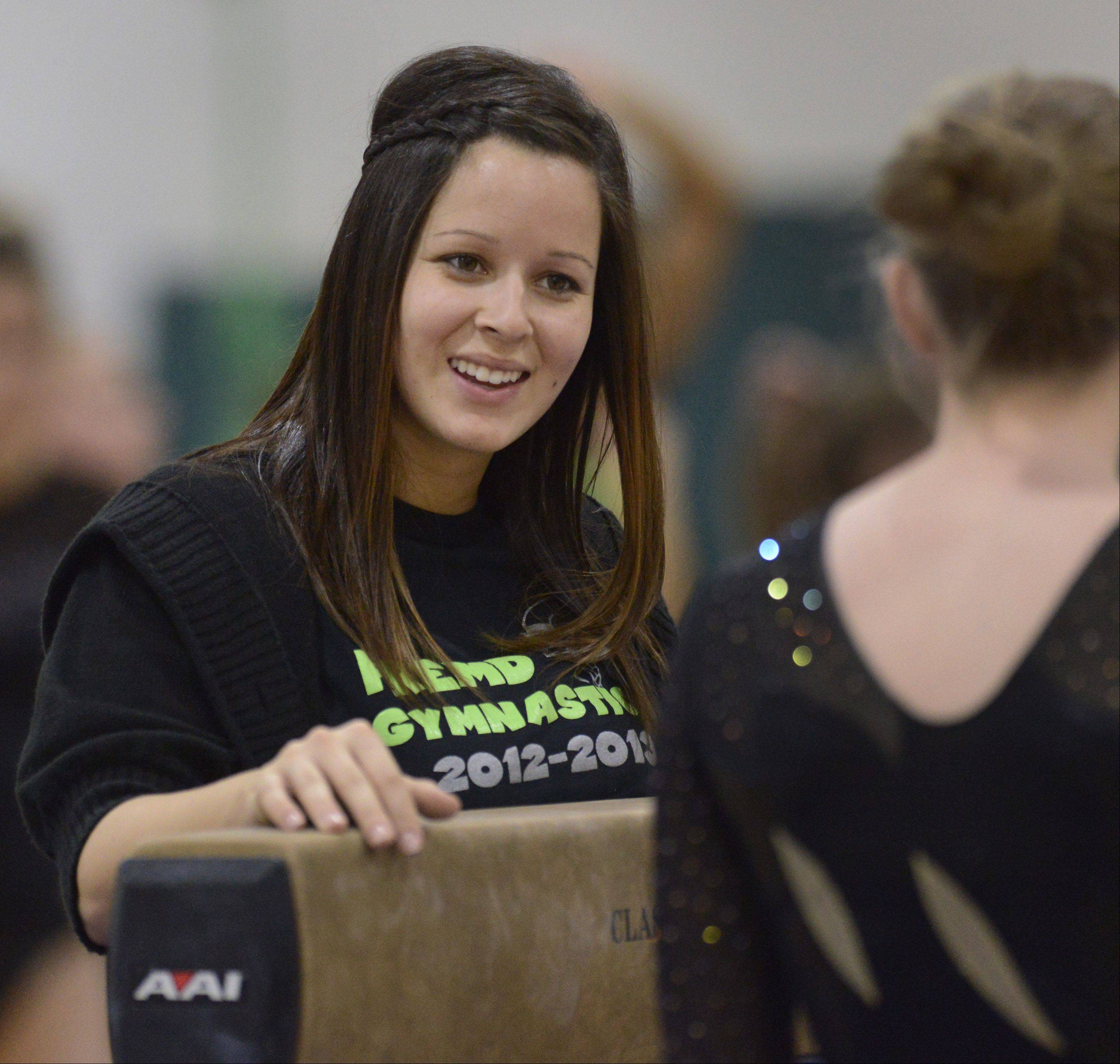 Fremd girls gymnastics coach Elise Ference, left.