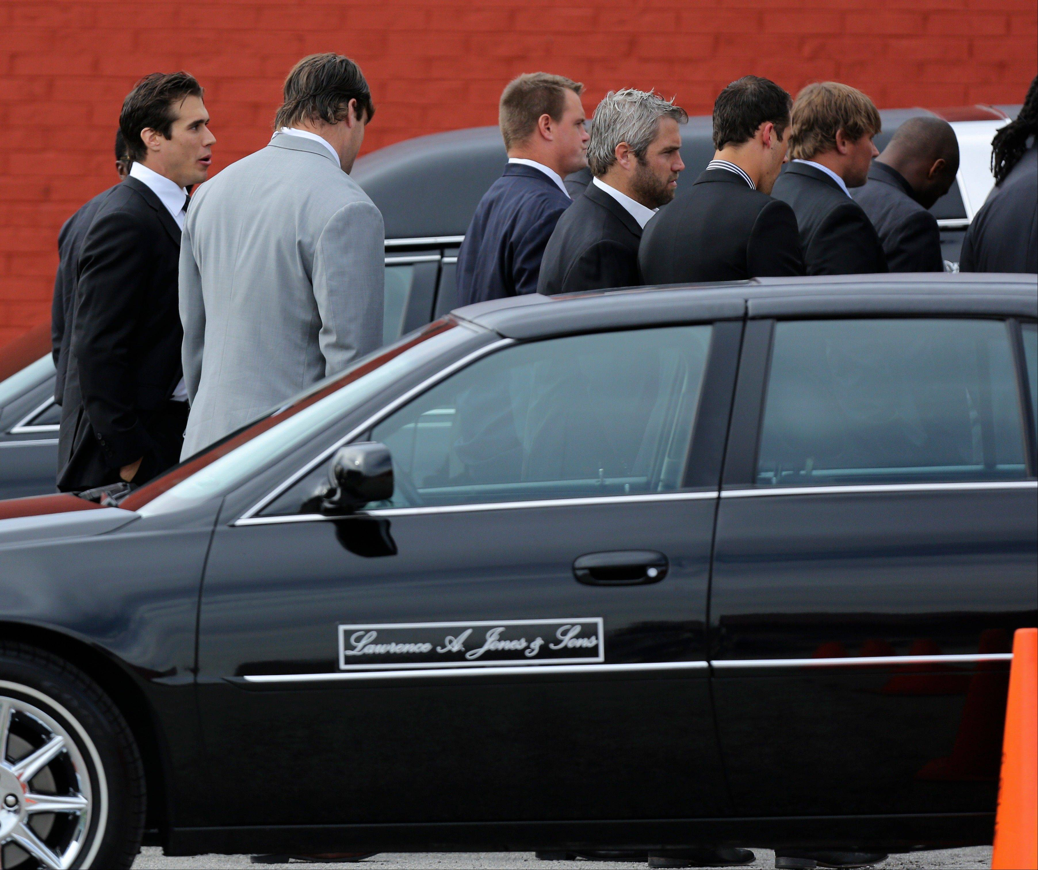 Kansas City Chiefs quarterback Brady Quinn, left, talks with a teammate Wednesday as they arrive at a memorial service for Kansas City Chiefs' Jovan Belcher at the Landmark International Deliverance and Worship Center in Kansas City, Mo. Belcher shot his girlfriend, Kasandra Perkins, at their home Saturday morning before driving to Arrowhead Stadium and turning the gun on himself.