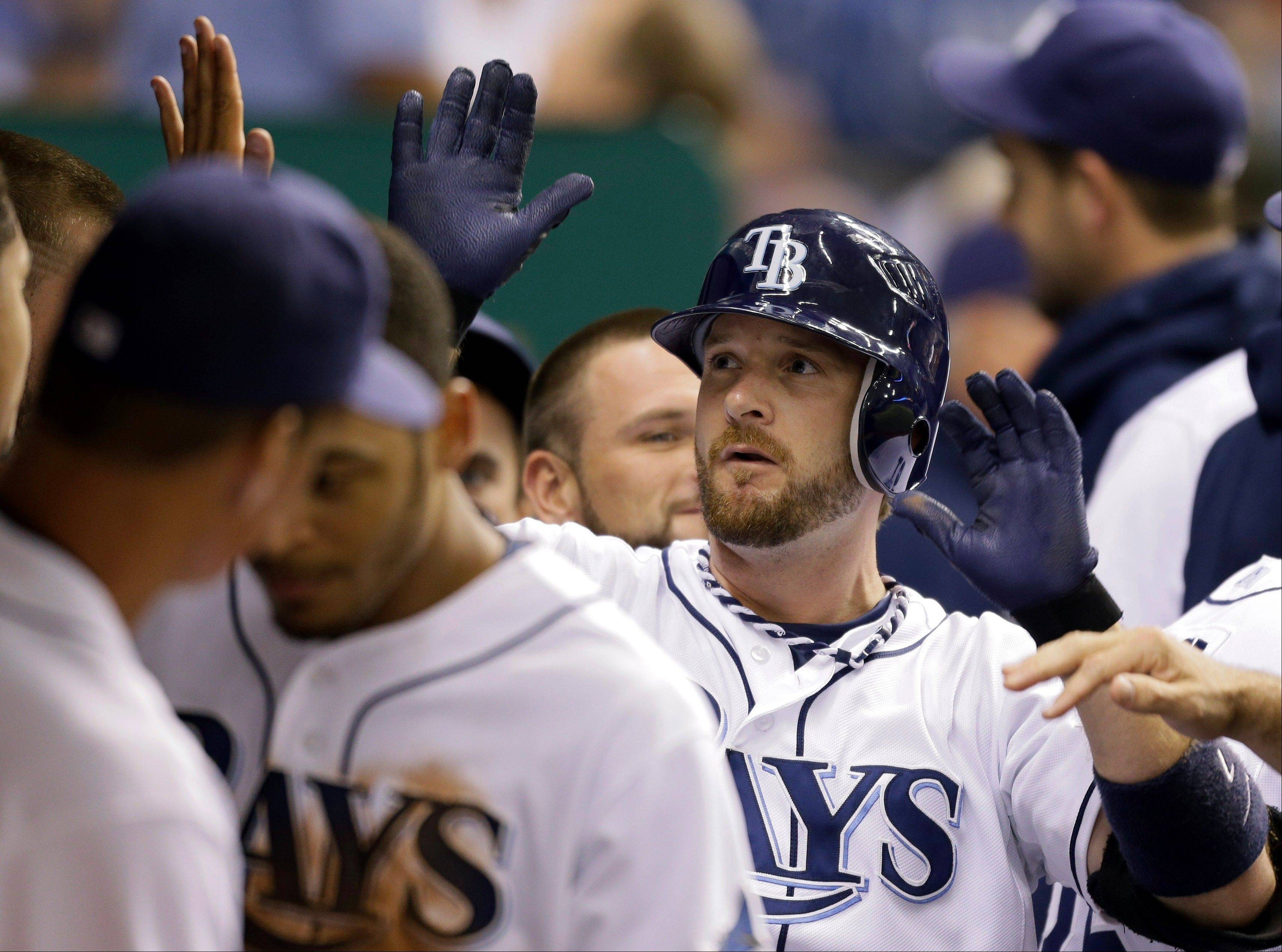 Jeff Keppinger of the Tampa Bay Rays, high-fives teammates after blasting a home run against Boston last season. CBS is reporting he has agreed to a three-year deal with the White Sox.