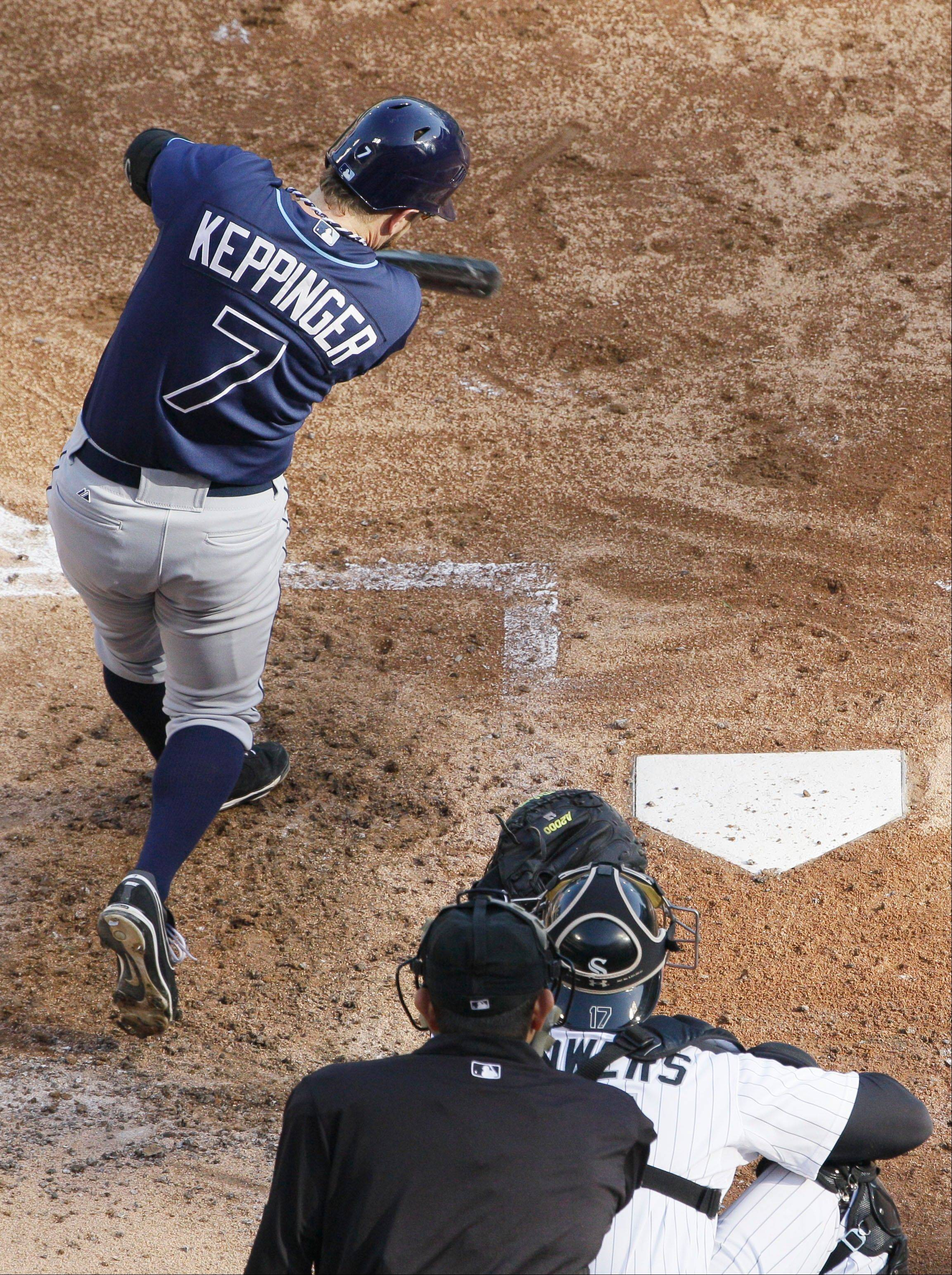 Jeff Keppinger of the Rays hits a two-run home run against the White Sox on Sept. 29, 2012. Keppinger reportedly has signed a three-year deal to play third base for the White Sox.