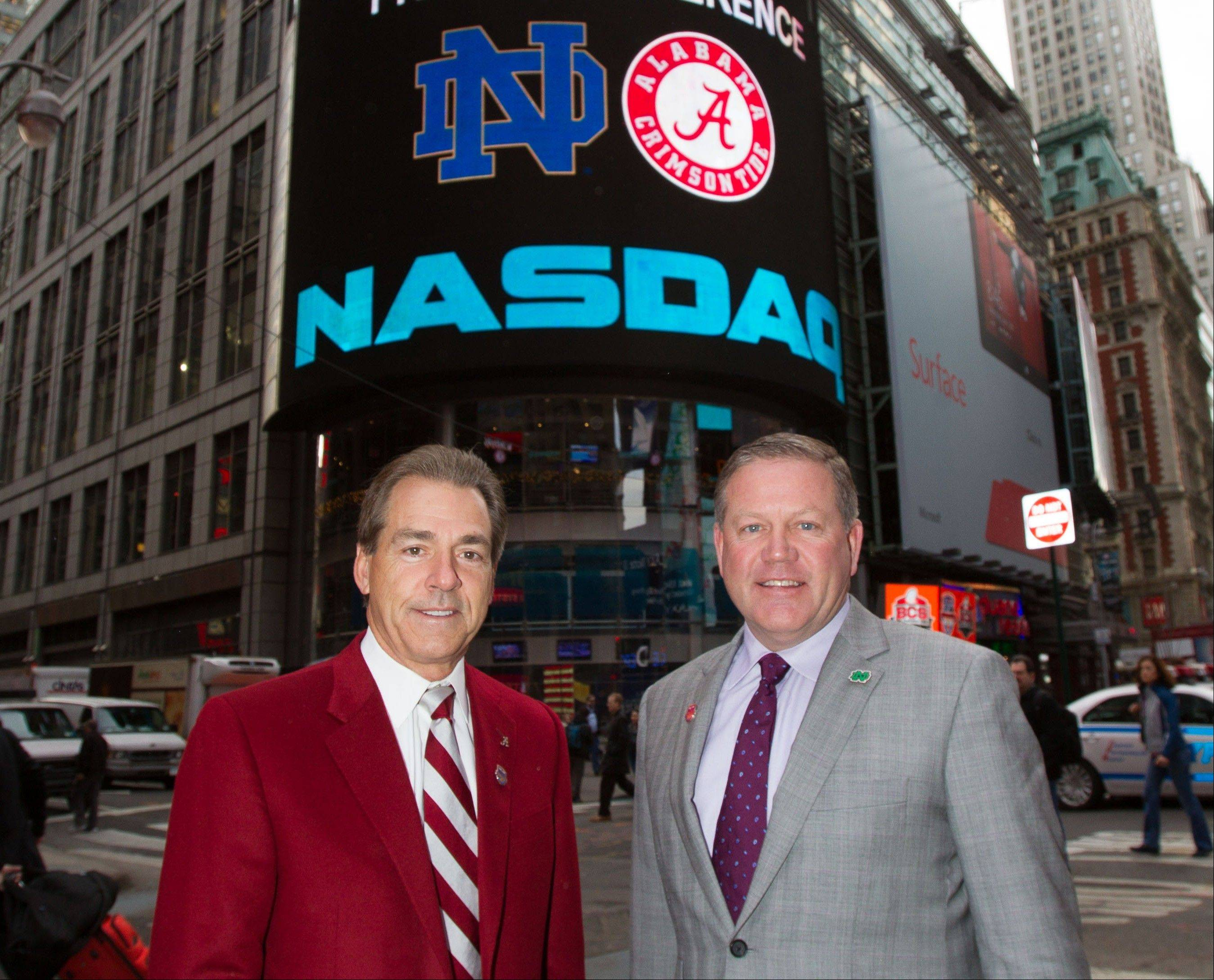 University of Alabama football coach Nick Saban, left, poses Wednesday with Notre Dame football coach Brian Kelly outside of the Nasdaq MarketSite in New York.