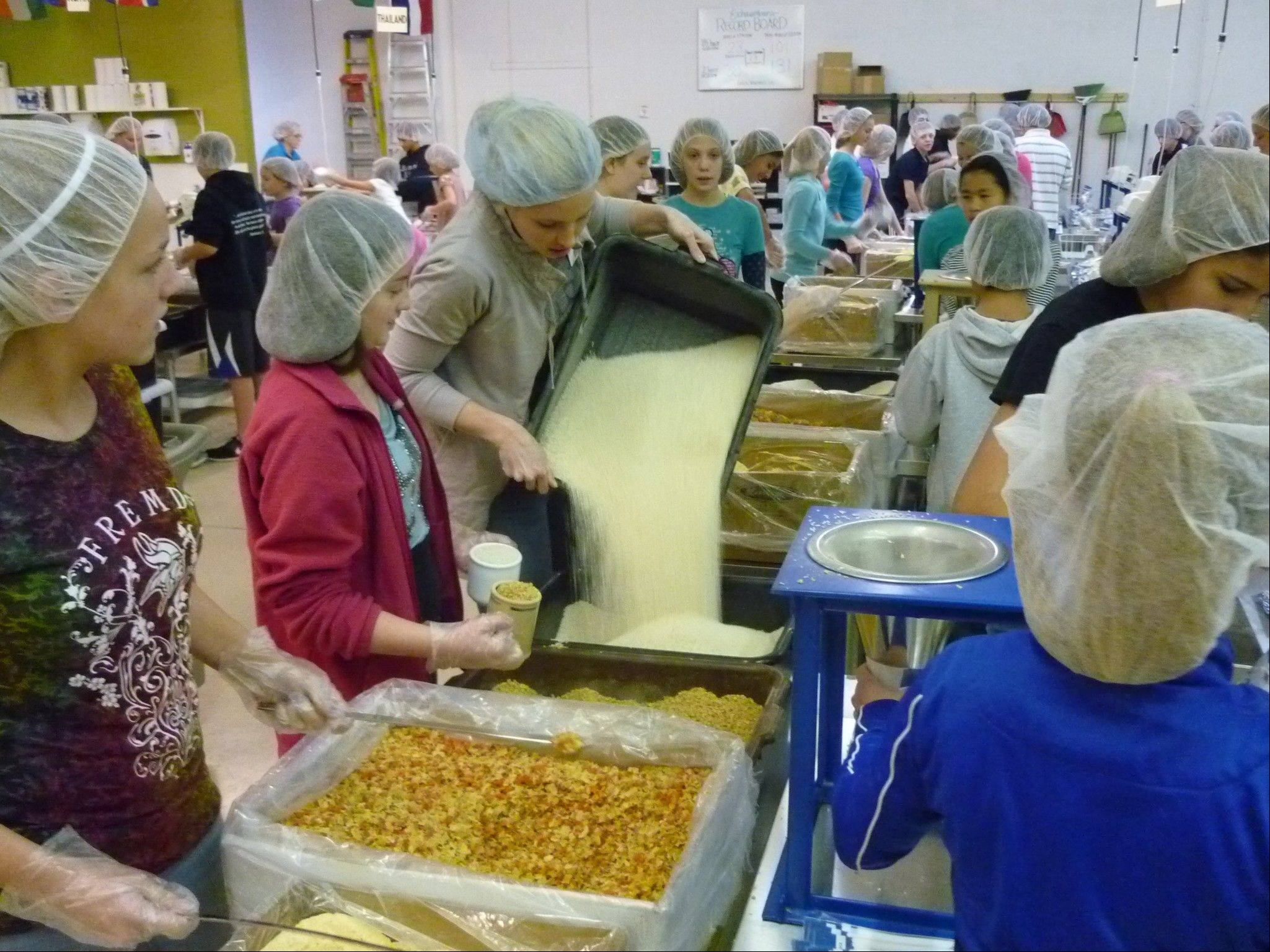 More than 200 students, teachers and parents from Immanuel Lutheran School in Palatine, prepared 41,040 meals for hungry children in Swaziland, Africa and Colombia, South America, through Feed My Starving Children.