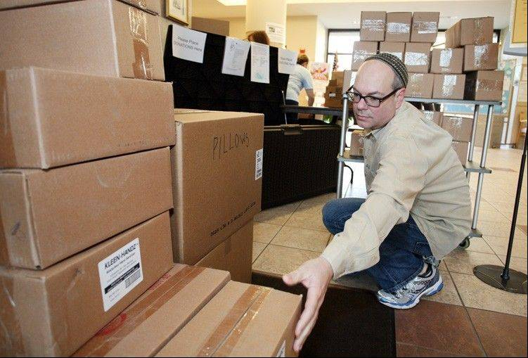 Rabbi Sidney Helbraun of Temple Beth-El helps with the boxes of donated items for victims of Hurricane Sandy.